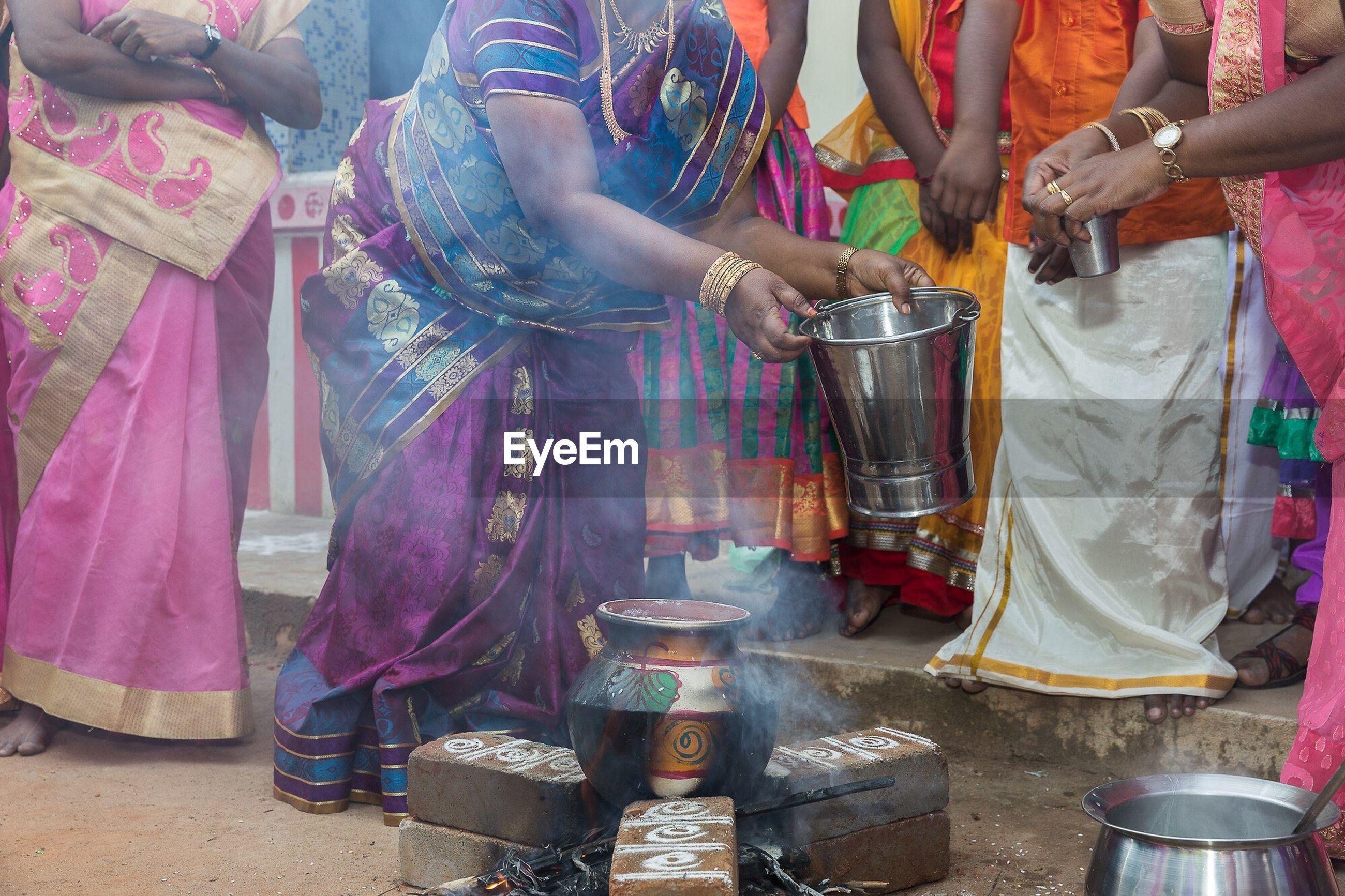 People performing religious ceremony