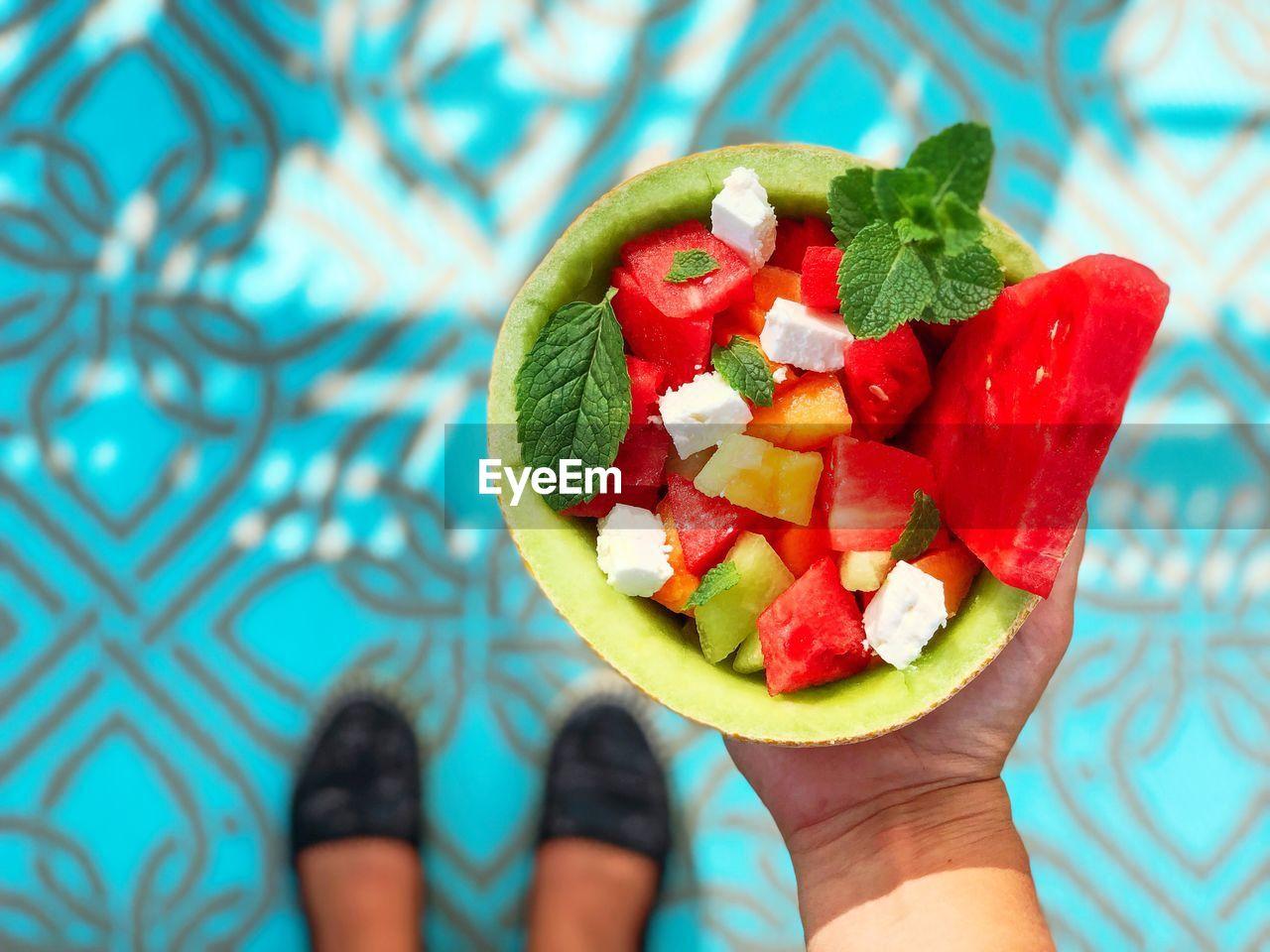 Cropped Hand Holding Fruit Salad