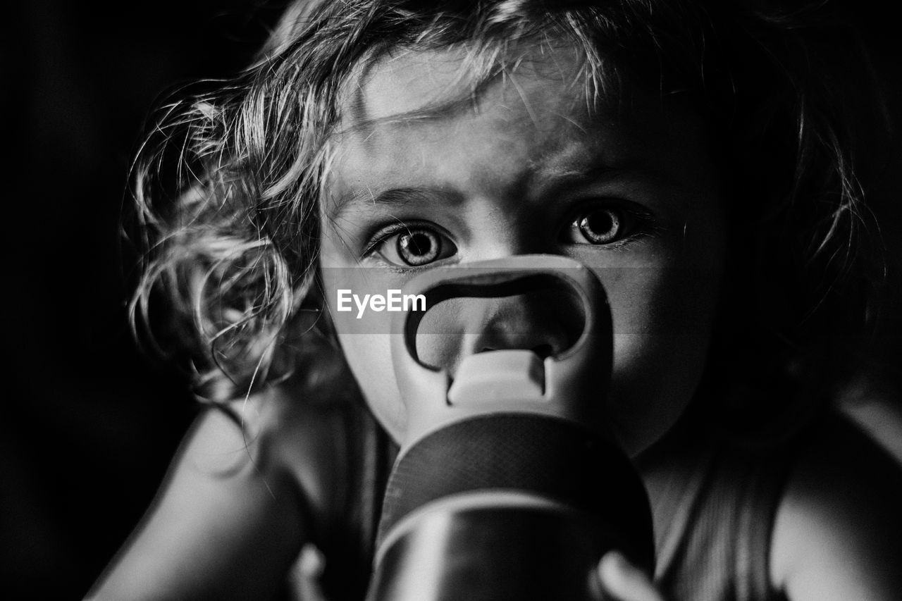 Close-Up Portrait Of Girl With Water Bottle