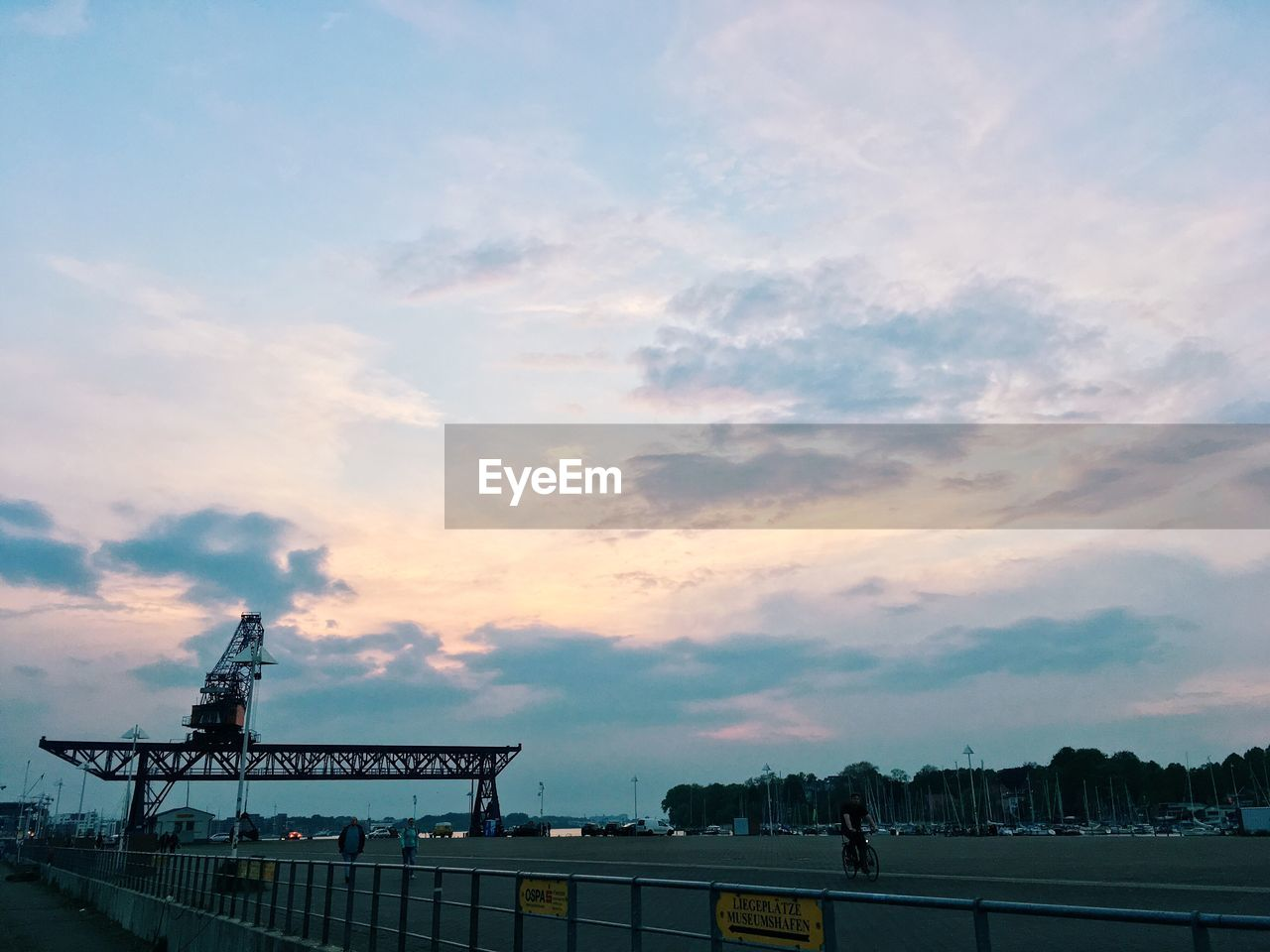 cloud - sky, sky, architecture, machinery, built structure, nature, sunset, industry, crane - construction machinery, construction industry, building exterior, transportation, outdoors, development, silhouette, no people, construction site, business, railing, low angle view, construction equipment