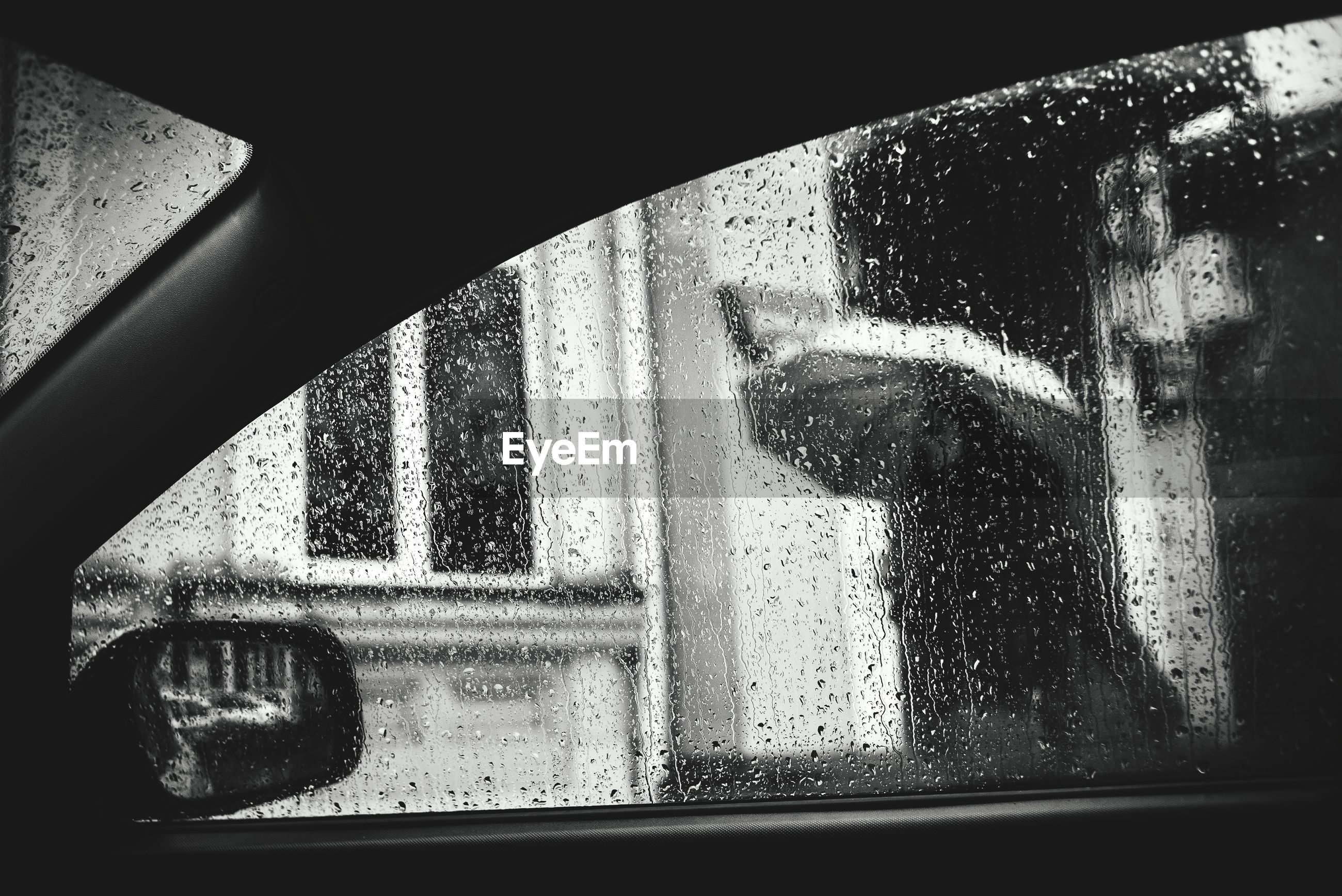 Close-up of car window during rainfall