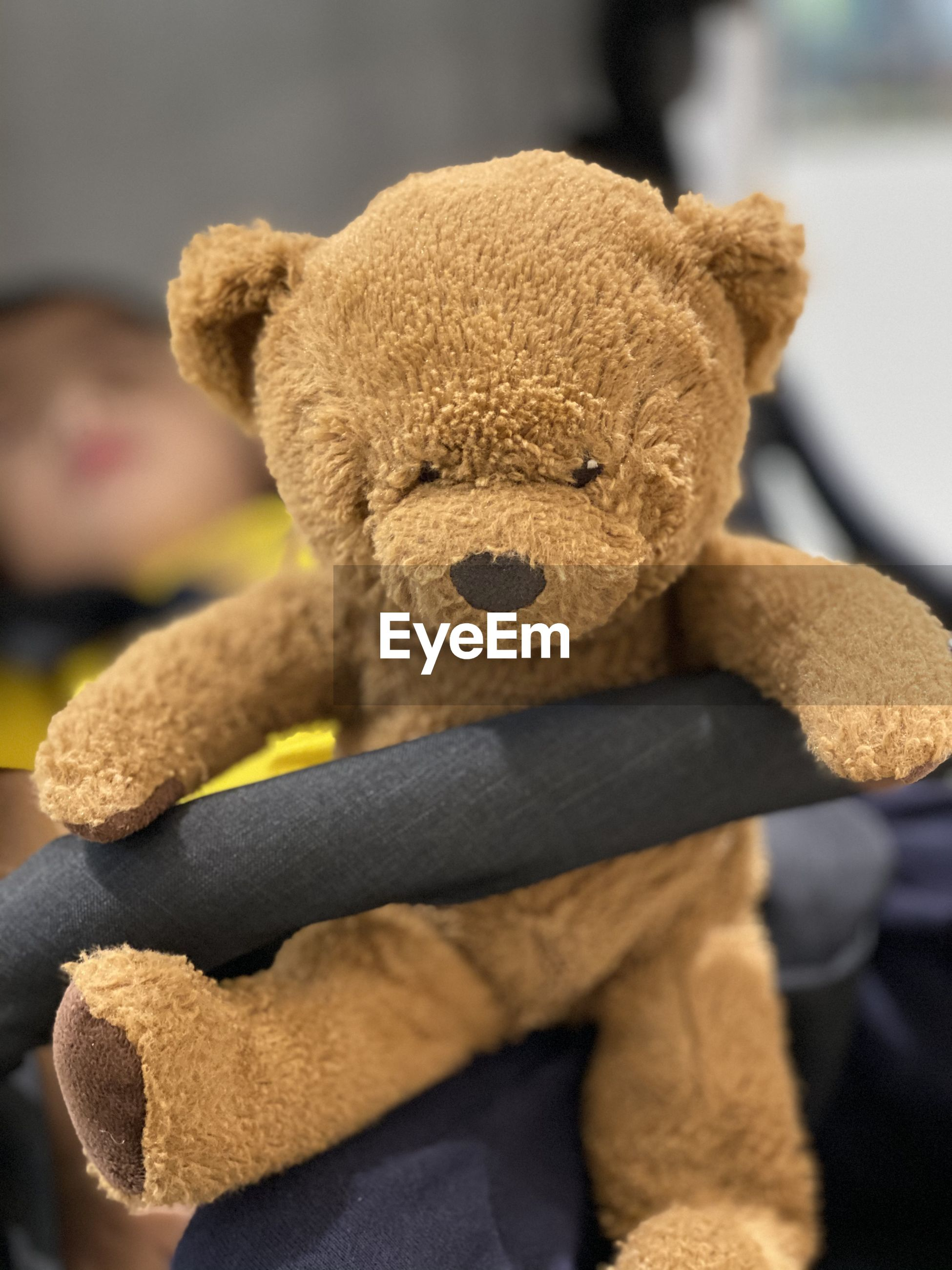 Close-up of stuffed toy on steering wheel in car