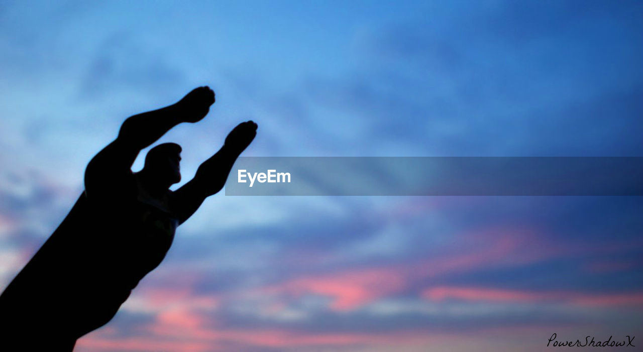 human hand, human body part, human finger, sky, silhouette, gesturing, low angle view, cloud - sky, outdoors, one person, sunset, day, nature, people, close-up, adult, adults only