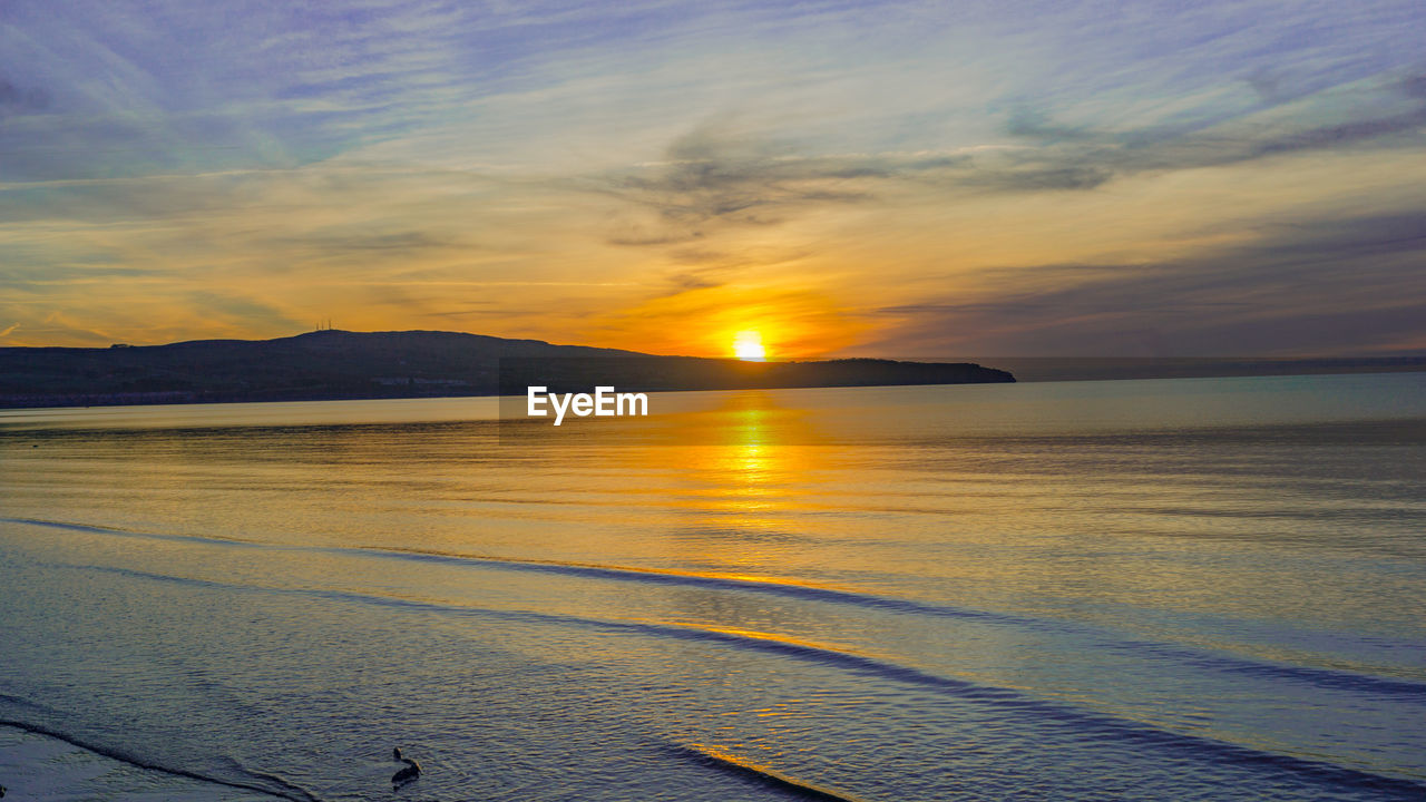sunset, sea, scenics, beauty in nature, nature, water, tranquil scene, tranquility, sky, idyllic, mountain, outdoors, no people, cloud - sky, horizon over water, beach, sun, day