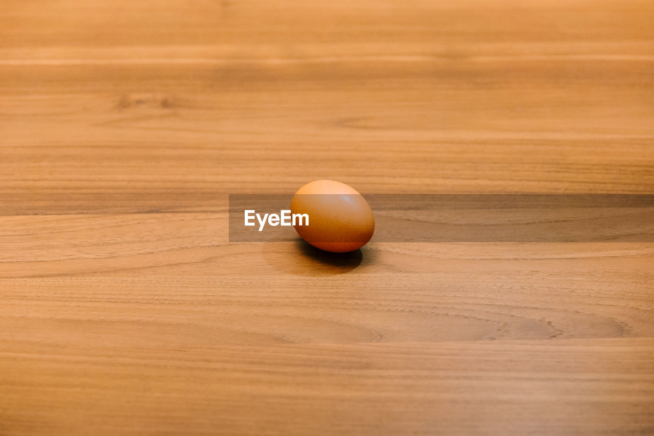 Close-Up Of Egg On Wooden Table