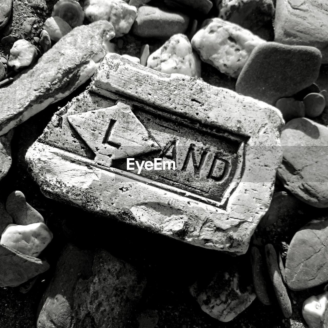 CLOSE-UP OF TEXT ON STONE