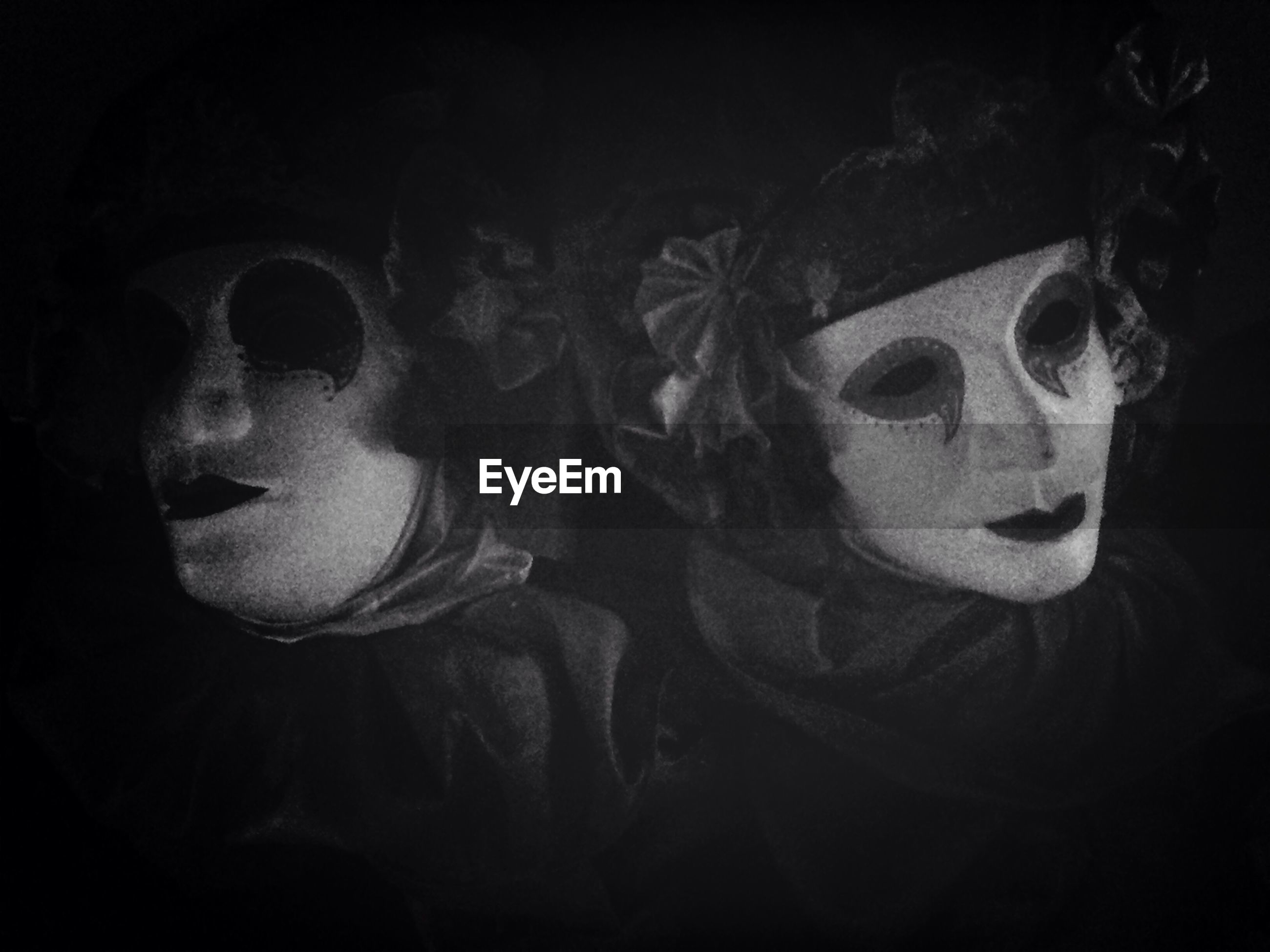 People with mask in darkroom