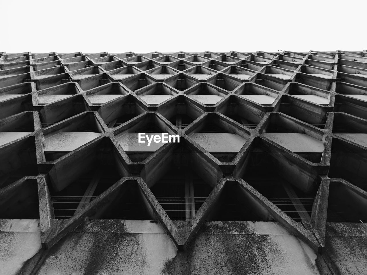 architecture, pattern, no people, built structure, sky, low angle view, day, building exterior, in a row, outdoors, arrangement, repetition, clear sky, stack, building, design, large group of objects, nature, metal, geometric shape, roof tile, architecture and art