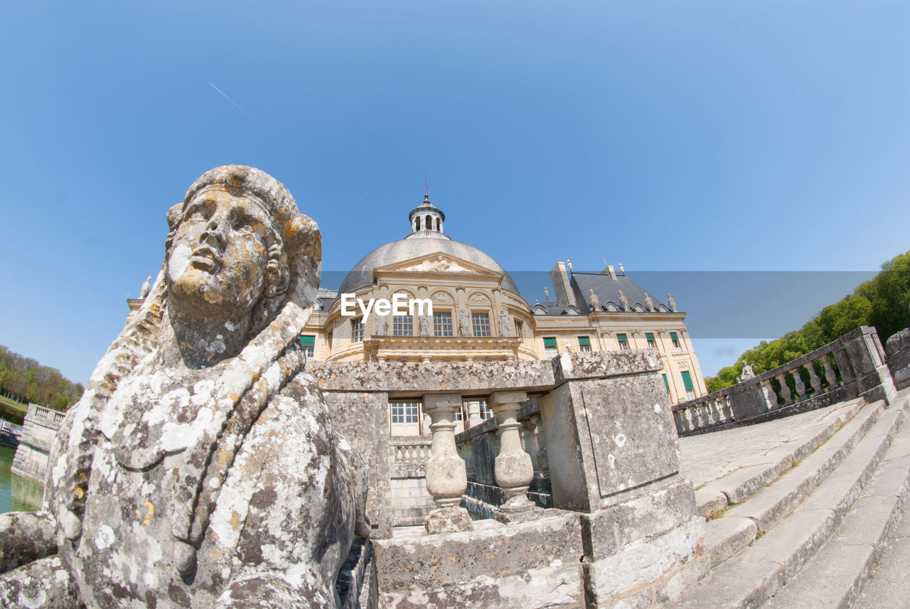 history, art and craft, statue, sculpture, architecture, day, built structure, low angle view, outdoors, travel destinations, sunlight, blue, no people, clear sky, building exterior, sky, ancient civilization