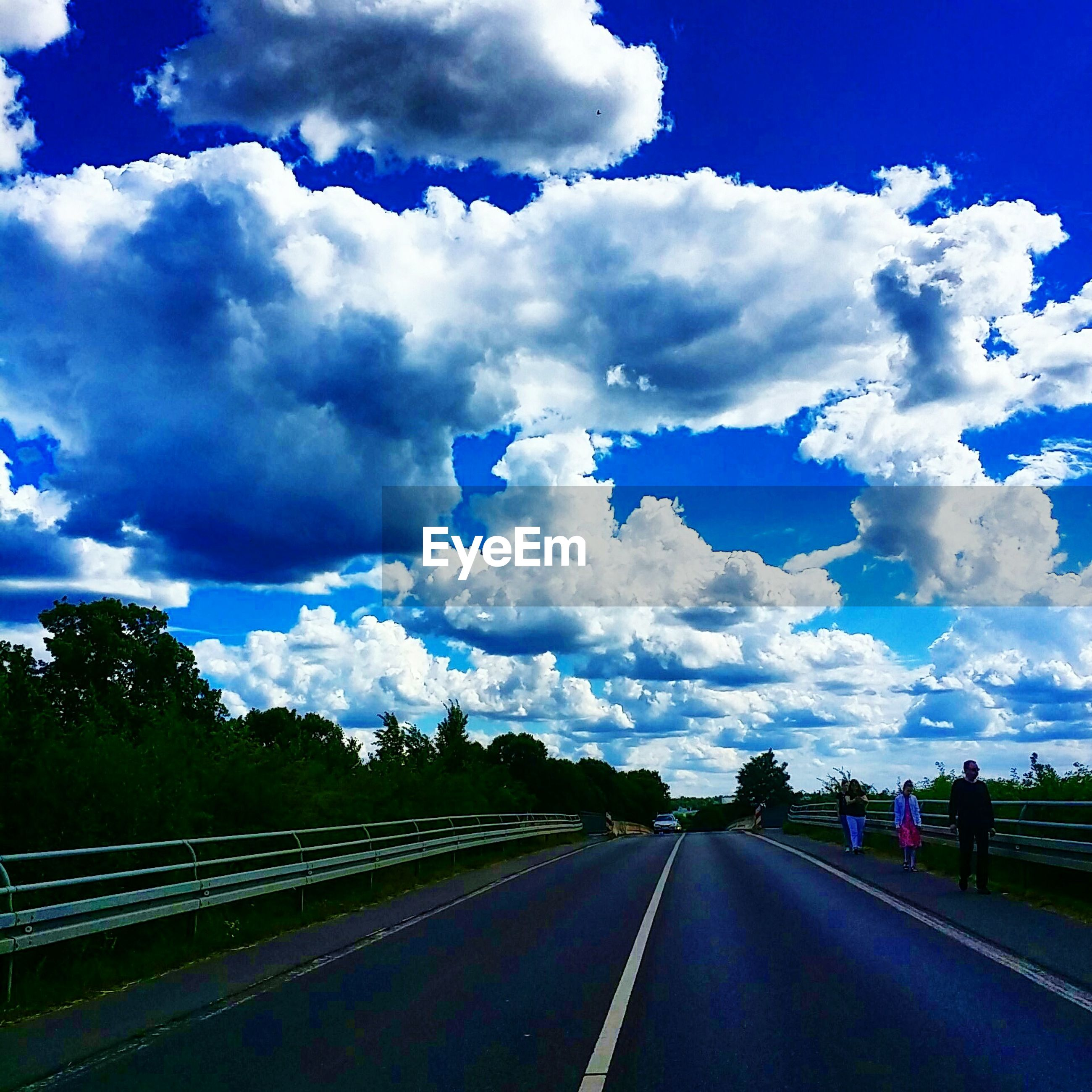 sky, transportation, cloud - sky, the way forward, road, cloudy, diminishing perspective, vanishing point, road marking, cloud, blue, nature, landscape, country road, highway, tree, day, empty, mode of transport, car