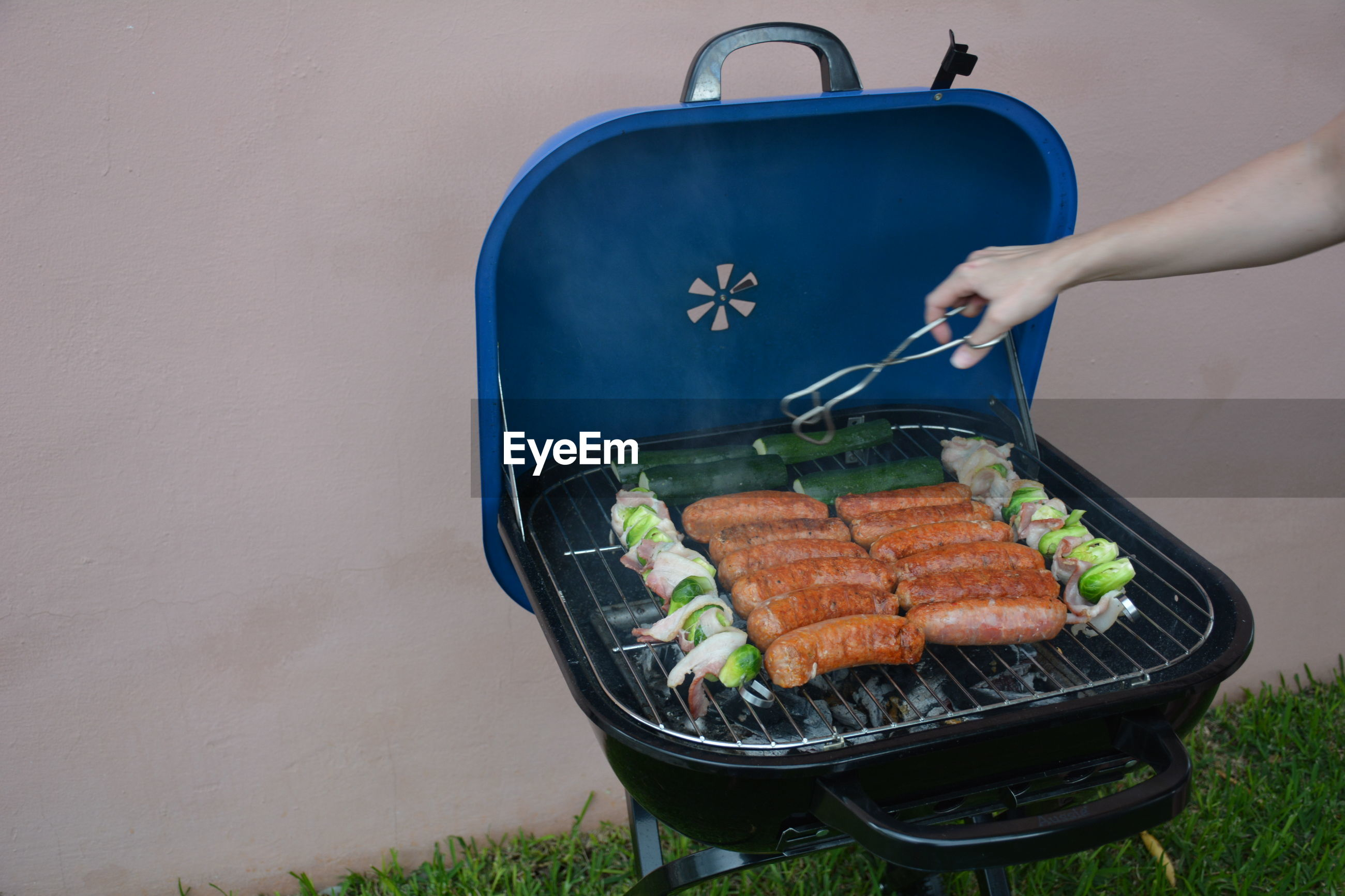High angle view of person preparing food on barbecue