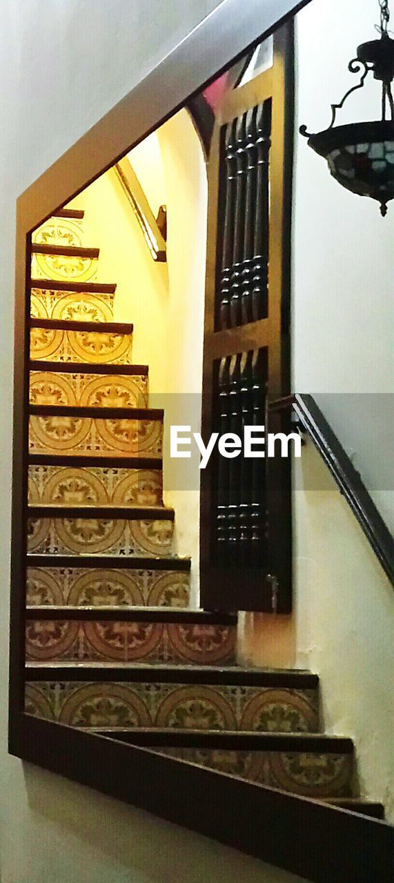 staircase, steps, steps and staircases, railing, architecture, stairs, no people, indoors, built structure, hand rail, close-up, day