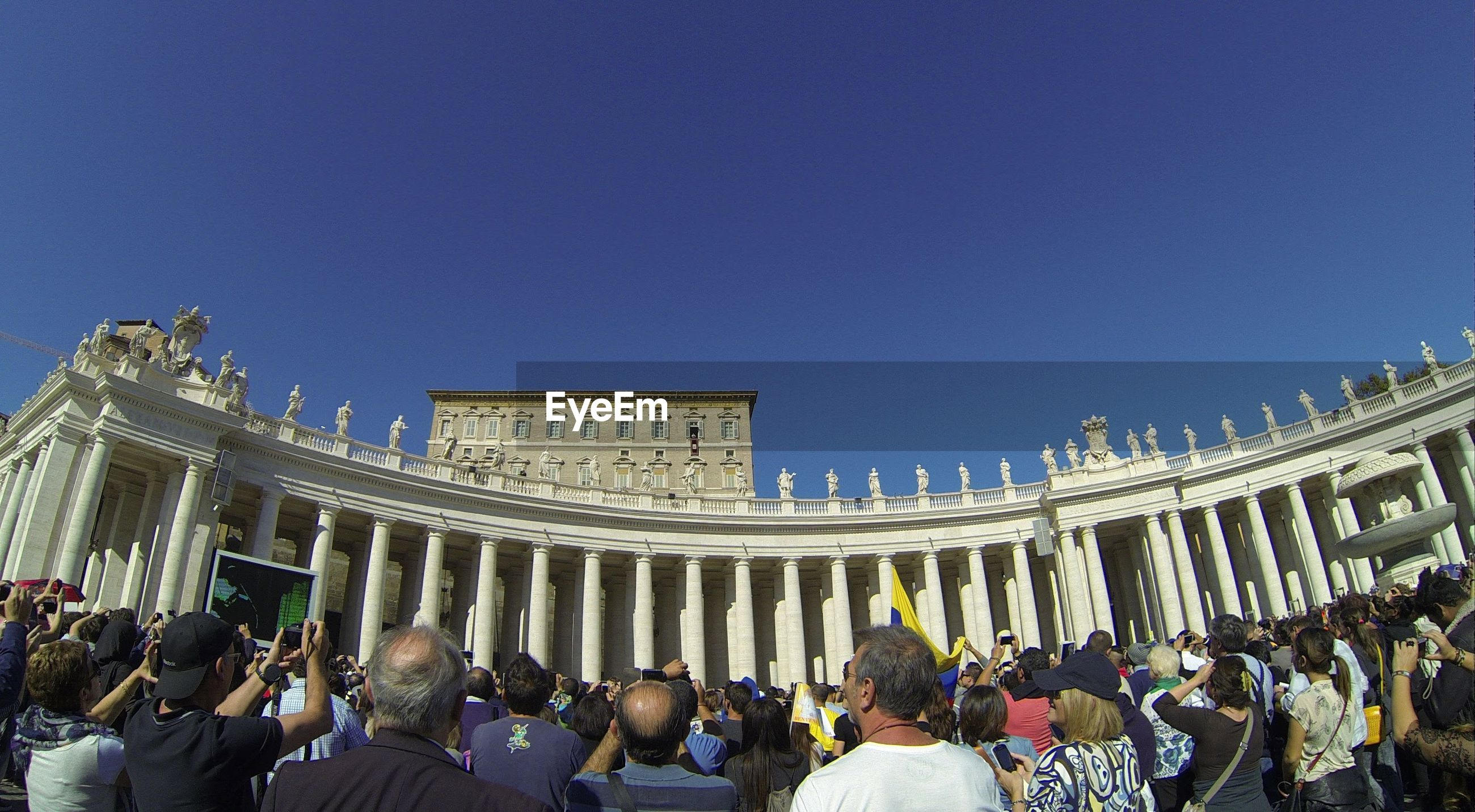 Crowd at st peter basilica against clear sky