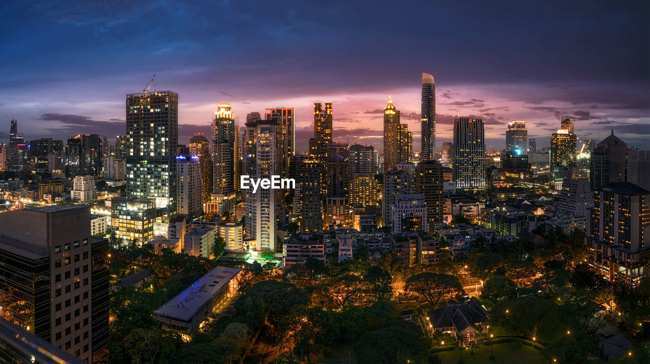 Illuminated Skyscrapers Against Sky At Twilight At Lang Suan District
