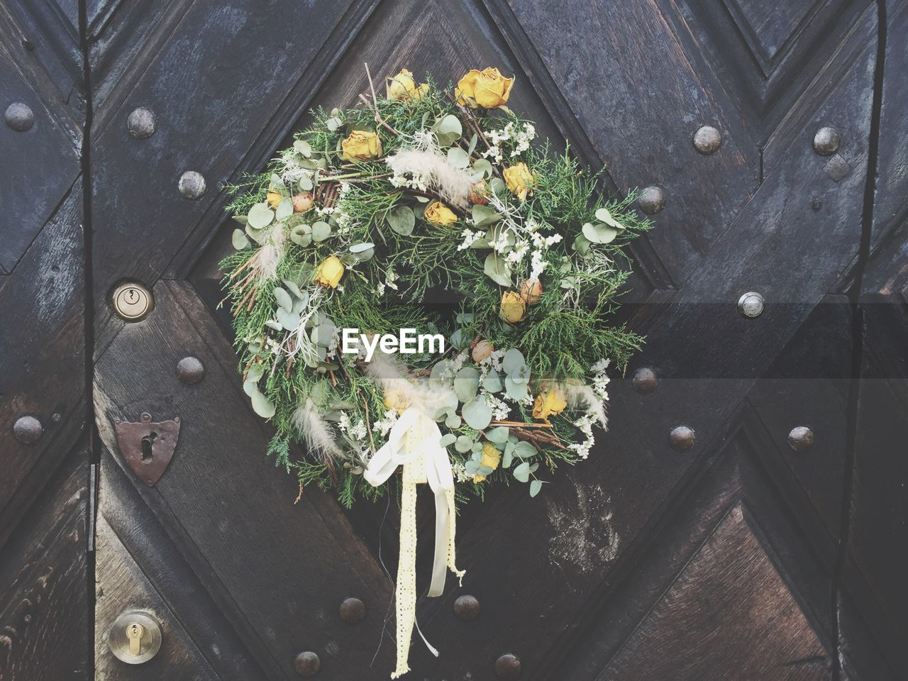 Close-Up Of Easter Wreath On Door