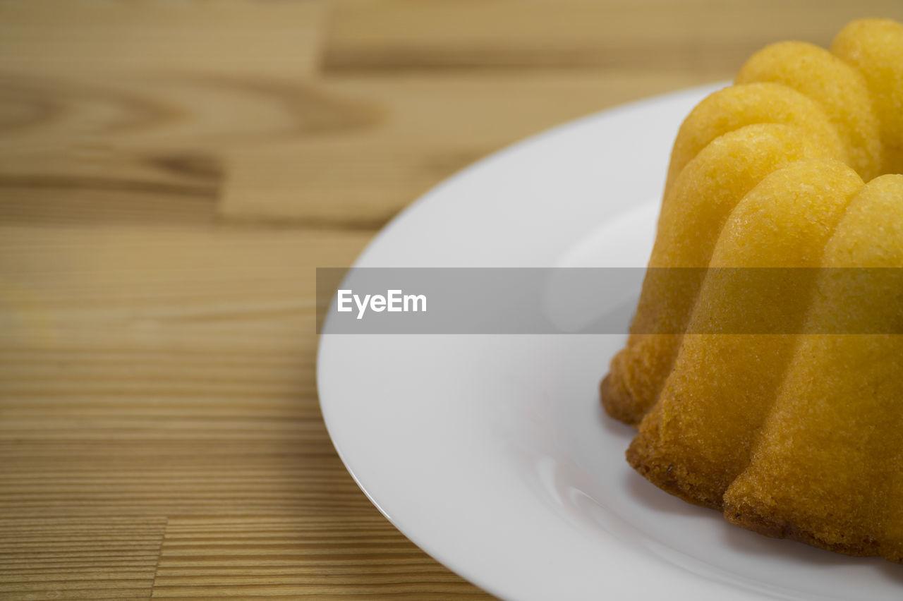 Close-Up Of Bundt Lemon Cake In Plate