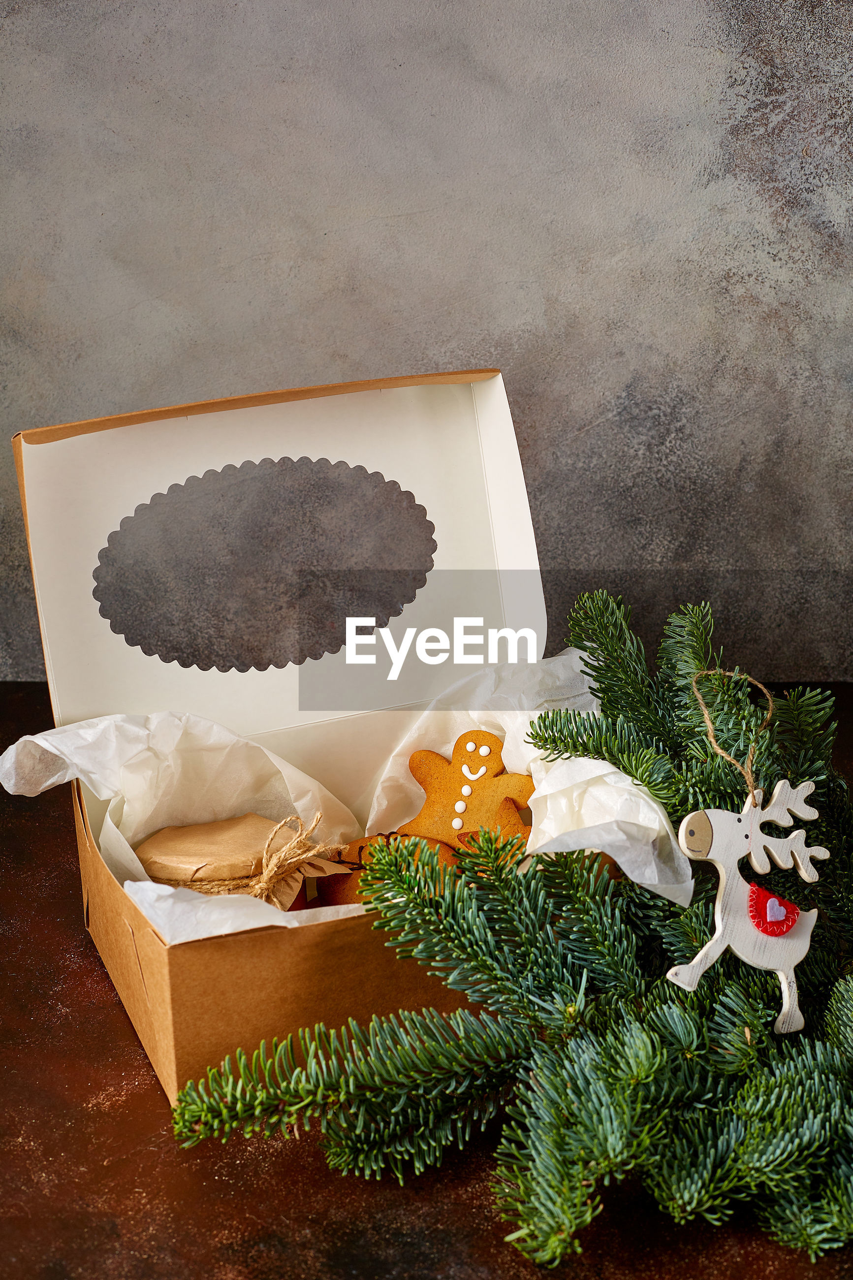 High angle view of christmas decorations with gingerbread cookies in box on table