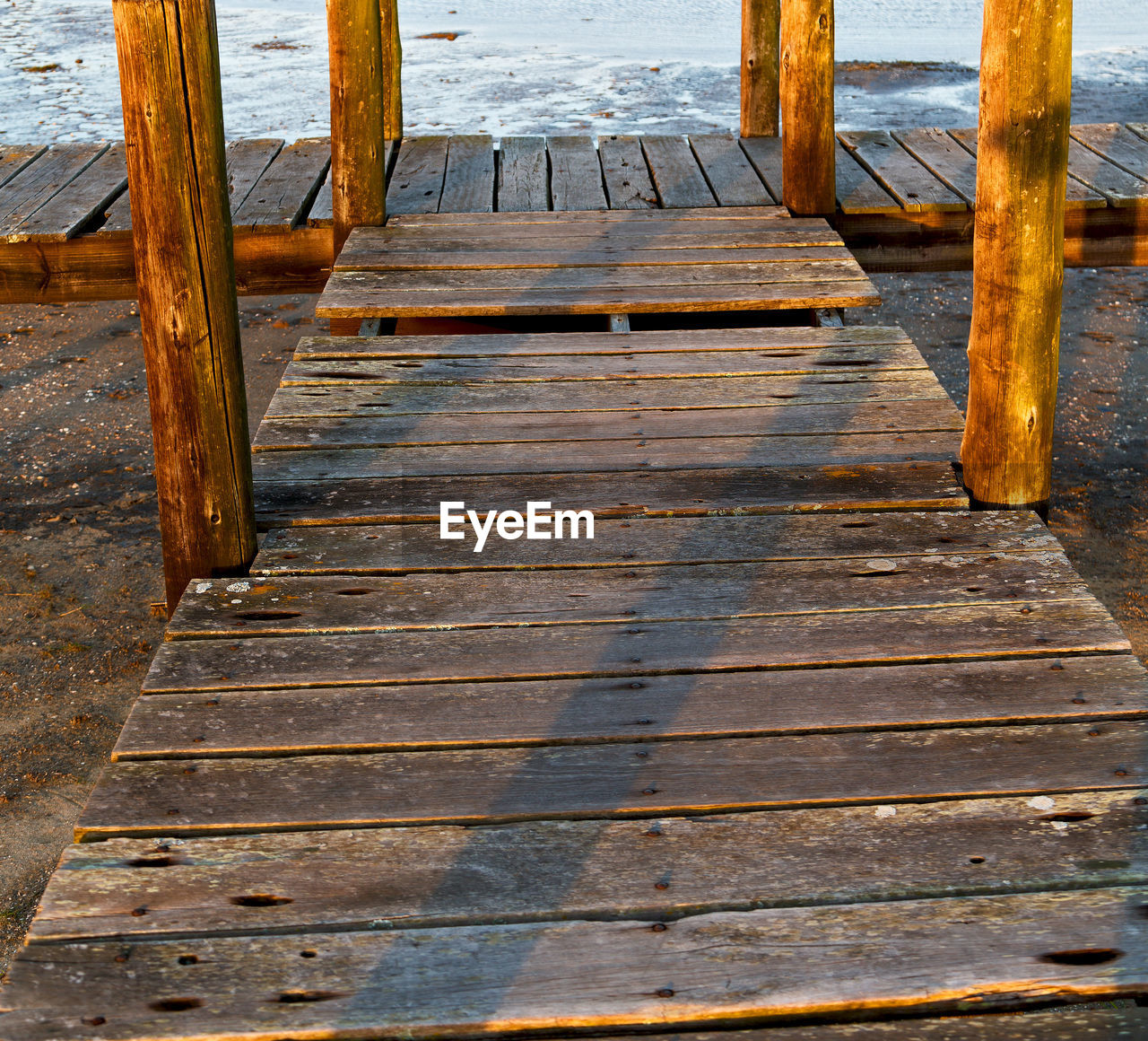 wood - material, water, no people, pier, day, architecture, nature, the way forward, outdoors, built structure, jetty, boardwalk, direction, pattern, wood paneling, sea, tranquility, high angle view, wooden post