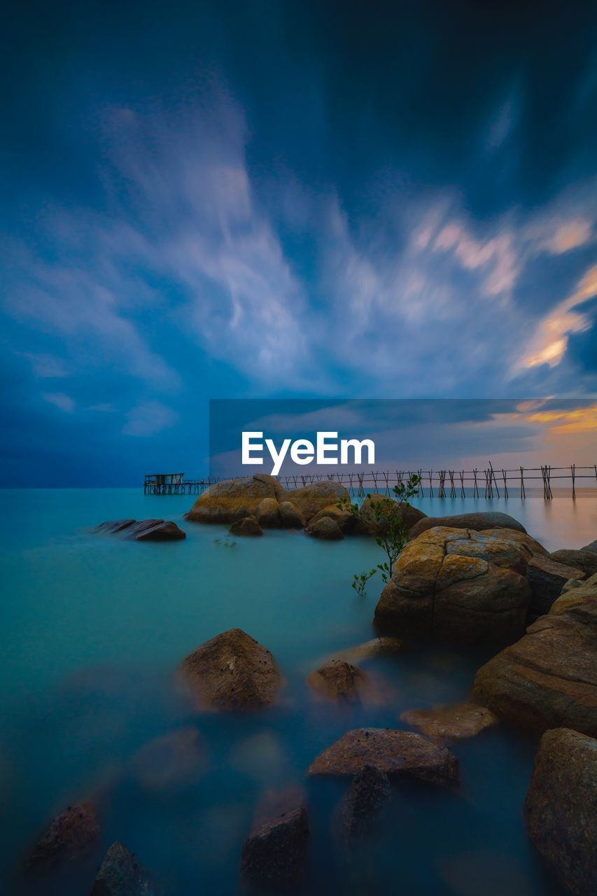 sky, water, sea, cloud - sky, rock, scenics - nature, beauty in nature, solid, rock - object, nature, tranquil scene, tranquility, no people, built structure, architecture, horizon over water, idyllic, land, horizon, outdoors