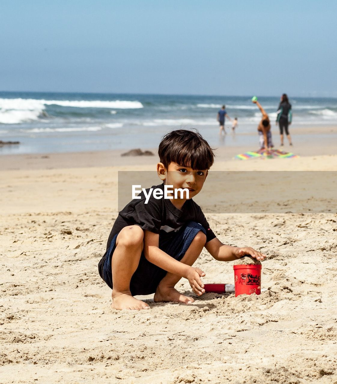 land, beach, child, childhood, sea, boys, men, sand, water, incidental people, males, playing, casual clothing, real people, leisure activity, nature, sky, people, horizon over water, outdoors, innocence