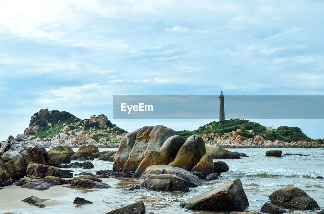 water, cloud - sky, sky, rock, solid, rock - object, nature, scenics - nature, sea, day, no people, beauty in nature, tranquility, architecture, tranquil scene, motion, rock formation, built structure, non-urban scene, outdoors
