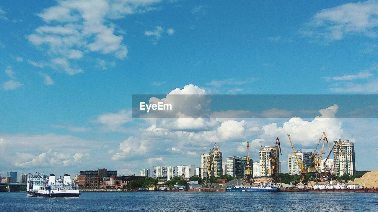 building exterior, cloud - sky, sky, built structure, architecture, transportation, water, mode of transport, waterfront, city, nautical vessel, day, sea, cityscape, freight transportation, outdoors, commercial dock, no people, harbor, skyscraper, nature, urban skyline
