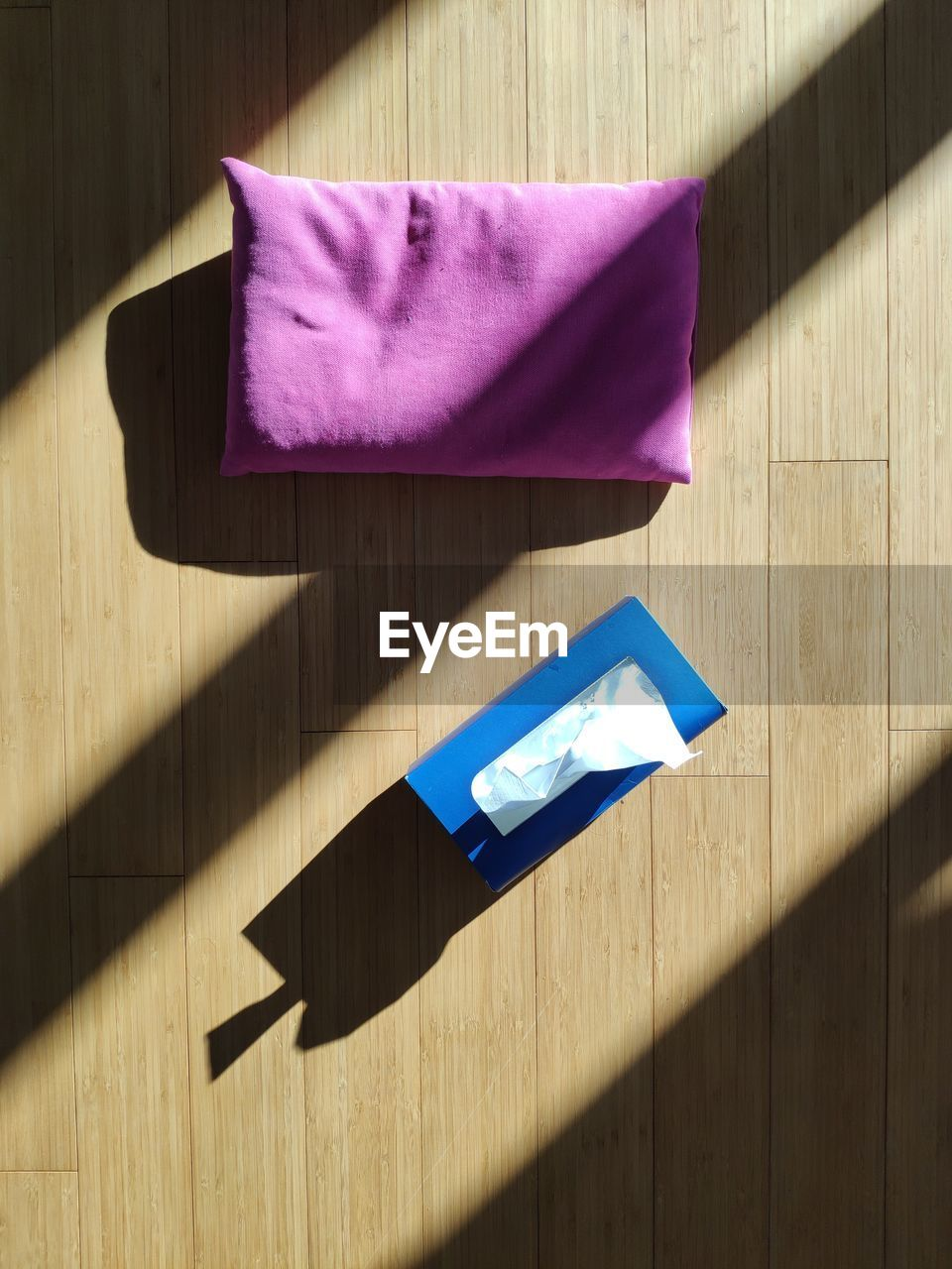 wood - material, no people, shadow, table, sunlight, indoors, art and craft, high angle view, paper, nature, still life, blue, origami, close-up, creativity, craft, day, flooring, wood, shape, purple