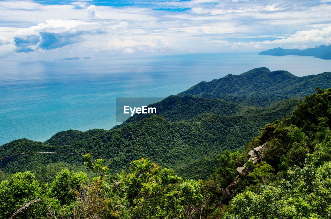 beauty in nature, scenics - nature, cloud - sky, tranquil scene, sky, tranquility, plant, tree, nature, sea, water, mountain, landscape, no people, environment, green color, day, non-urban scene, idyllic, outdoors