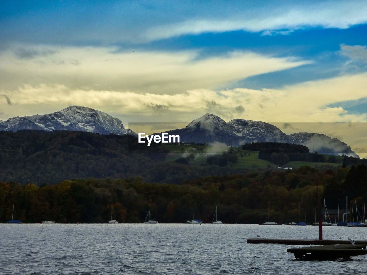 mountain, water, mountain range, scenics, nature, tranquility, sky, tranquil scene, beauty in nature, waterfront, no people, lake, outdoors, transportation, nautical vessel, cloud - sky, day, landscape