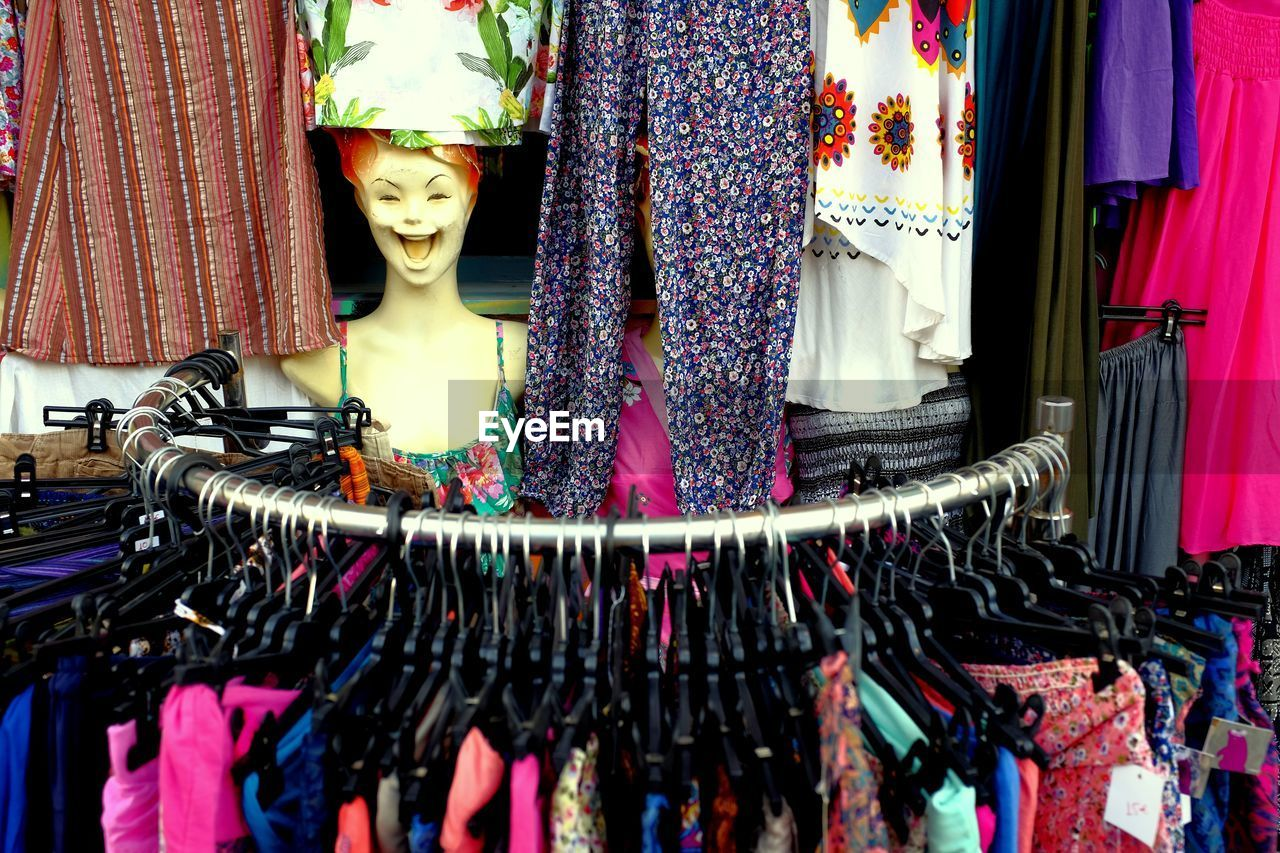 Clothes hanging in store for sale