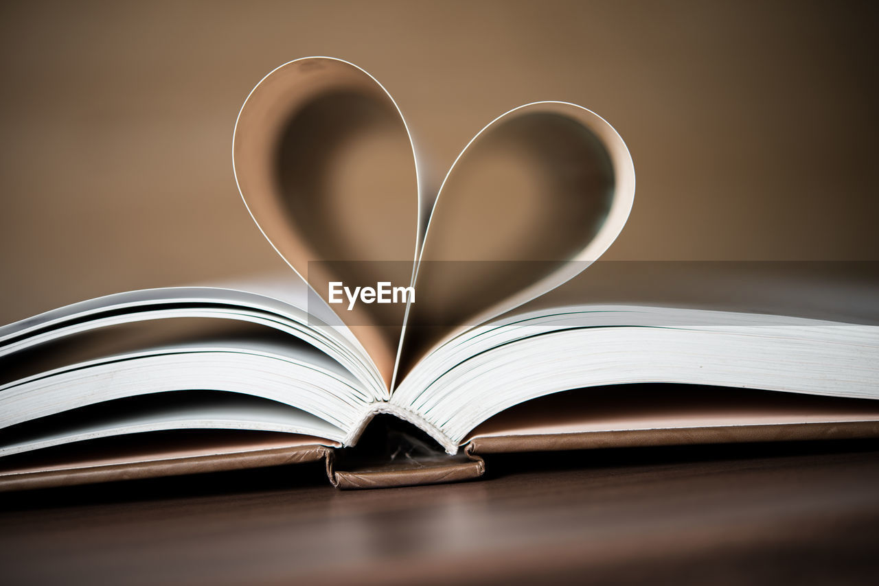 publication, book, page, heart shape, creativity, still life, paper, open, indoors, education, table, positive emotion, love, literature, no people, close-up, emotion, selective focus, wisdom, folded