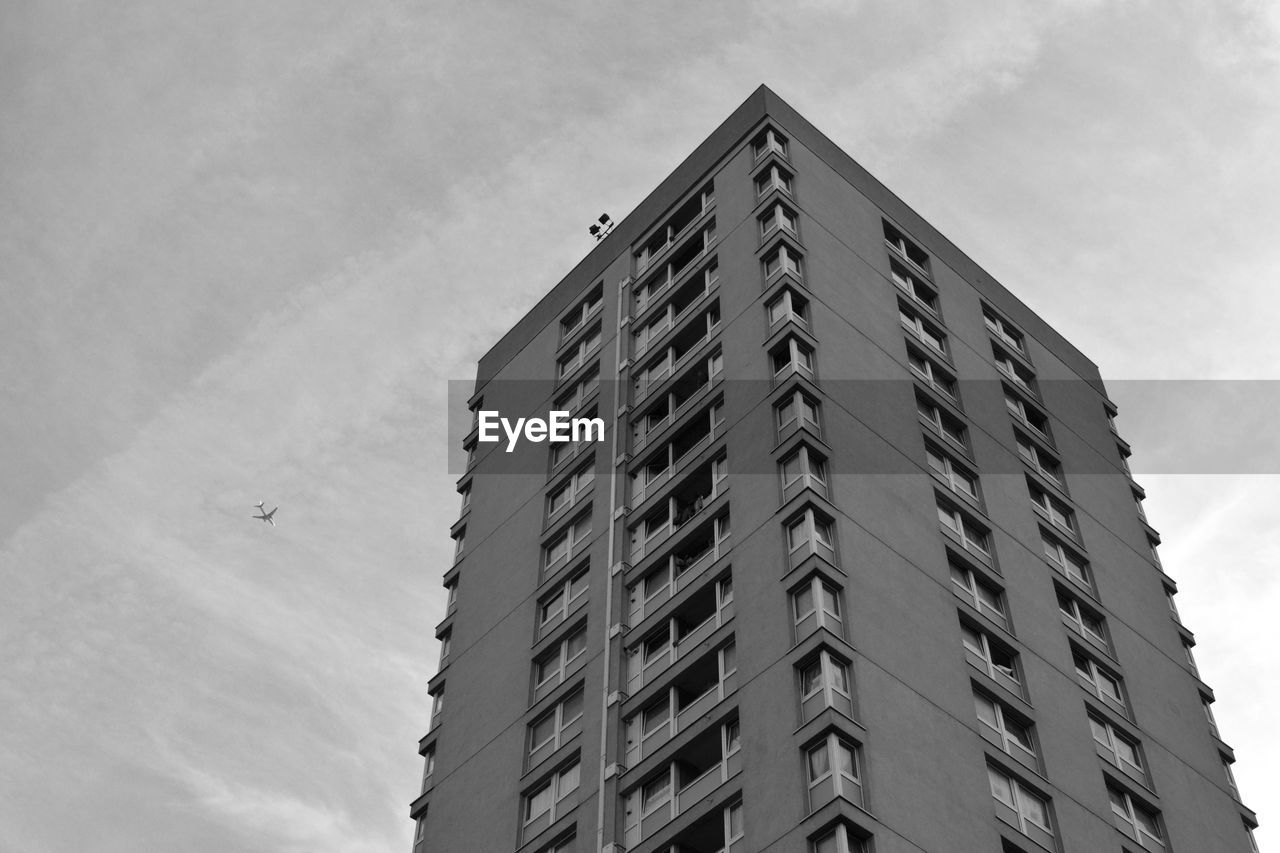 architecture, building exterior, low angle view, built structure, development, day, modern, window, sky, apartment, no people, outdoors, city