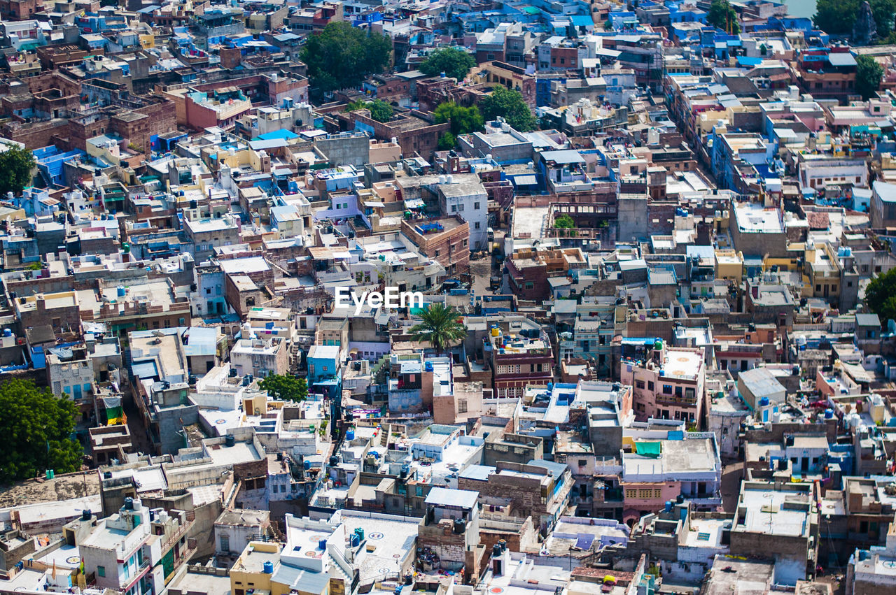 crowd, crowded, architecture, building exterior, high angle view, residential district, built structure, community, building, full frame, backgrounds, city, day, cityscape, house, outdoors, town, roof, travel destinations, urban sprawl, townscape