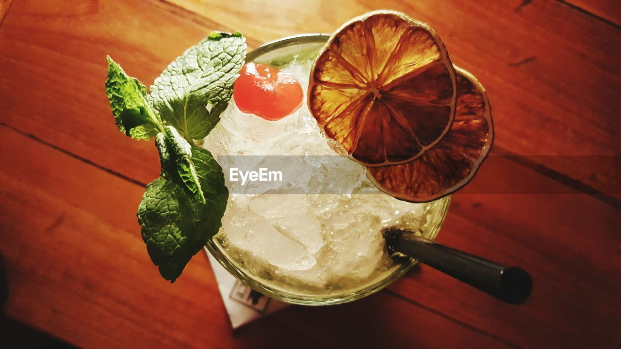 food and drink, food, table, freshness, high angle view, indoors, healthy eating, drink, drinking glass, no people, refreshment, mint leaf - culinary, serving size, ready-to-eat, garnish, slice, close-up, fruit, leaf, alcohol, mojito, day