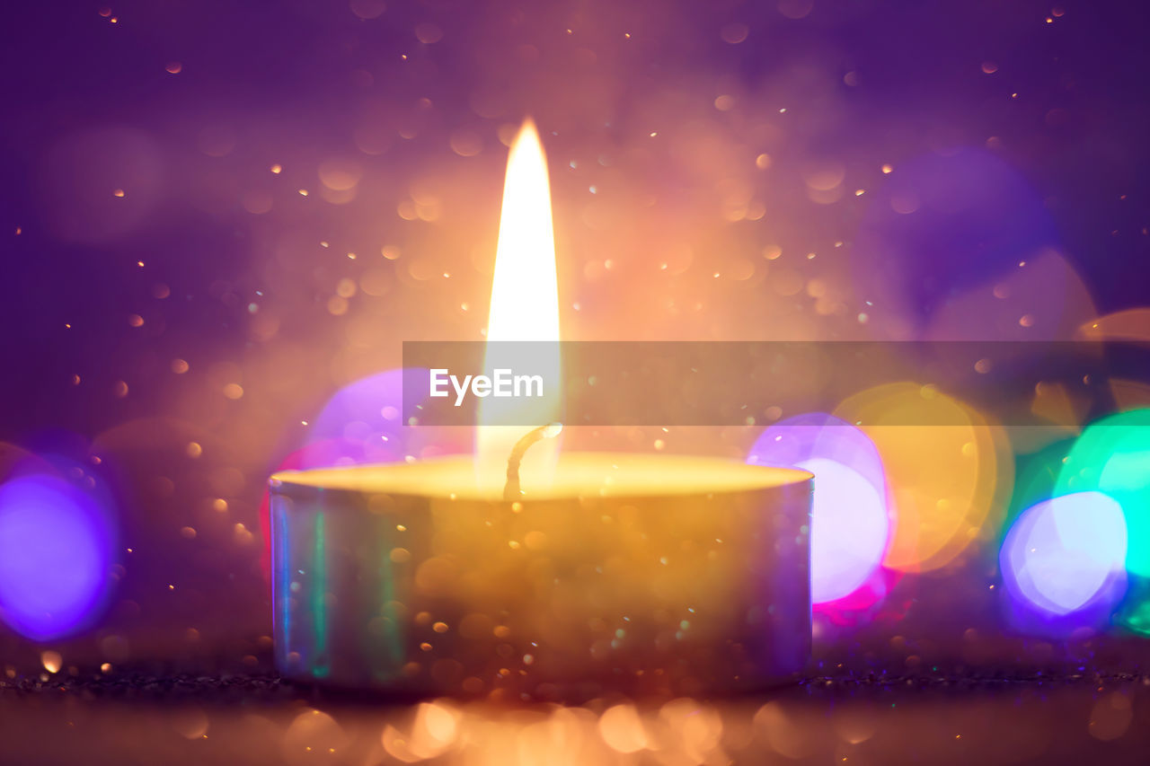 flame, fire, illuminated, burning, glowing, close-up, heat - temperature, no people, nature, fire - natural phenomenon, candle, indoors, multi colored, lighting equipment, motion, selective focus, lens flare, light - natural phenomenon, orange color, focus on foreground, purple