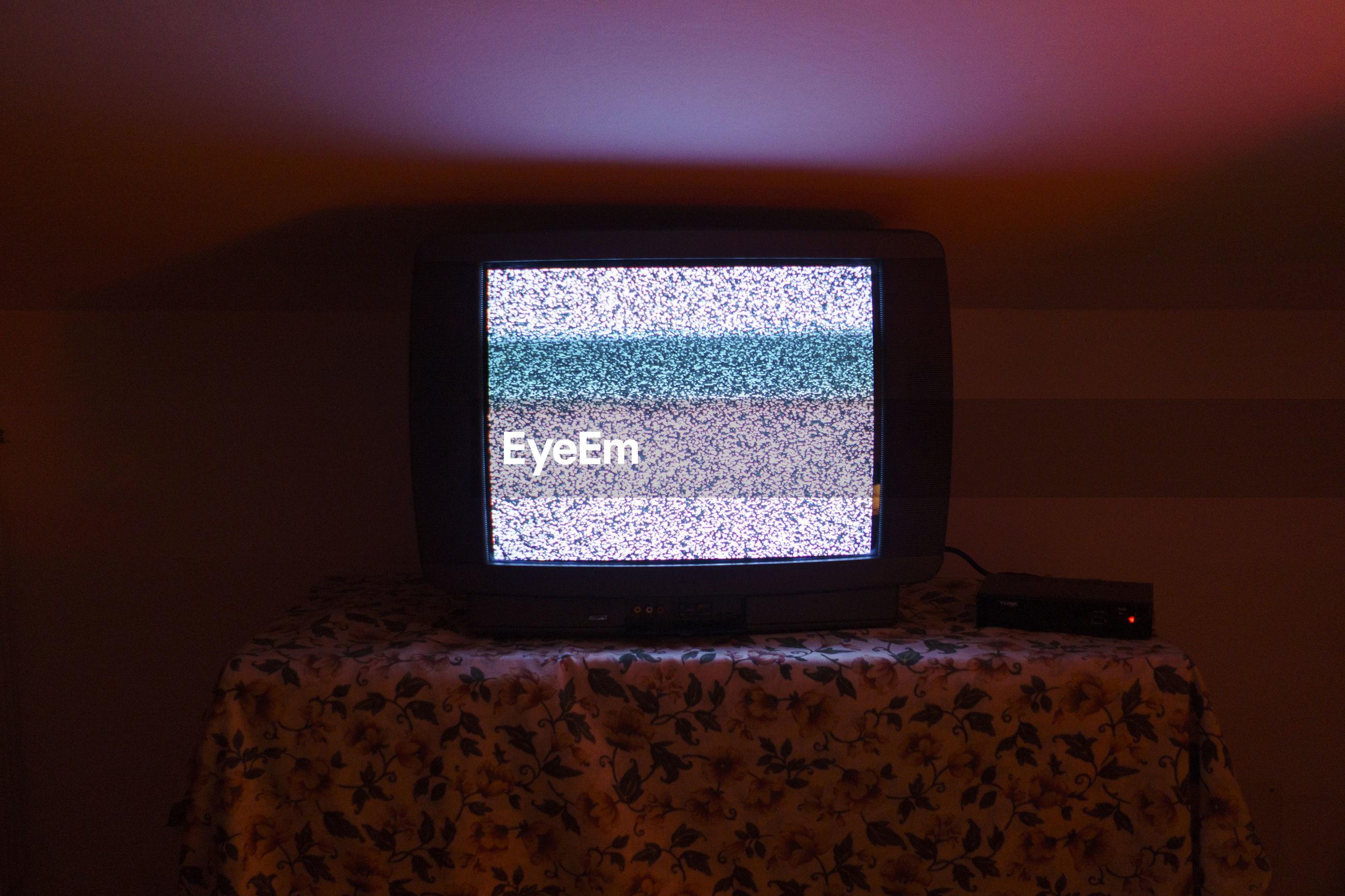 Close-up of tv at home
