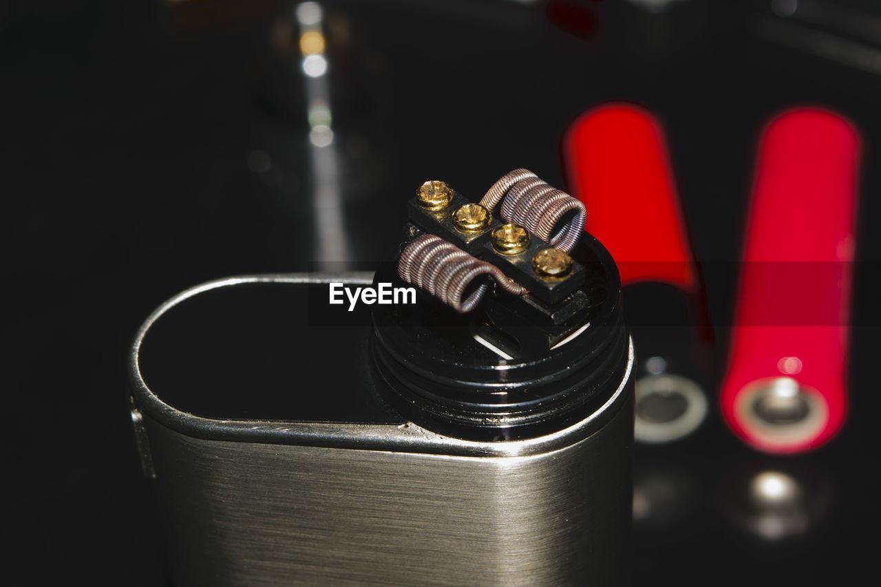 Close up of cigarette lighter against black background