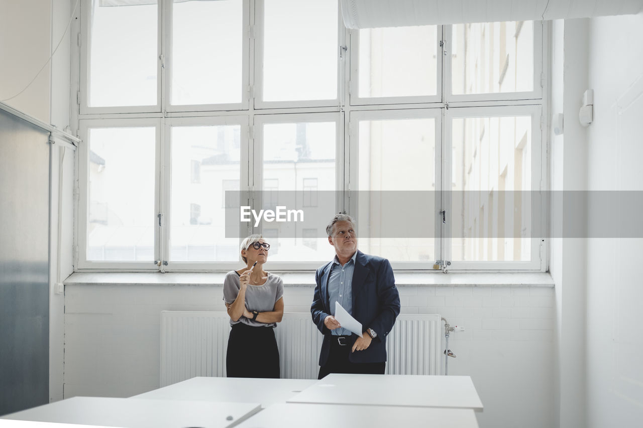 MAN AND WOMAN ON TABLE