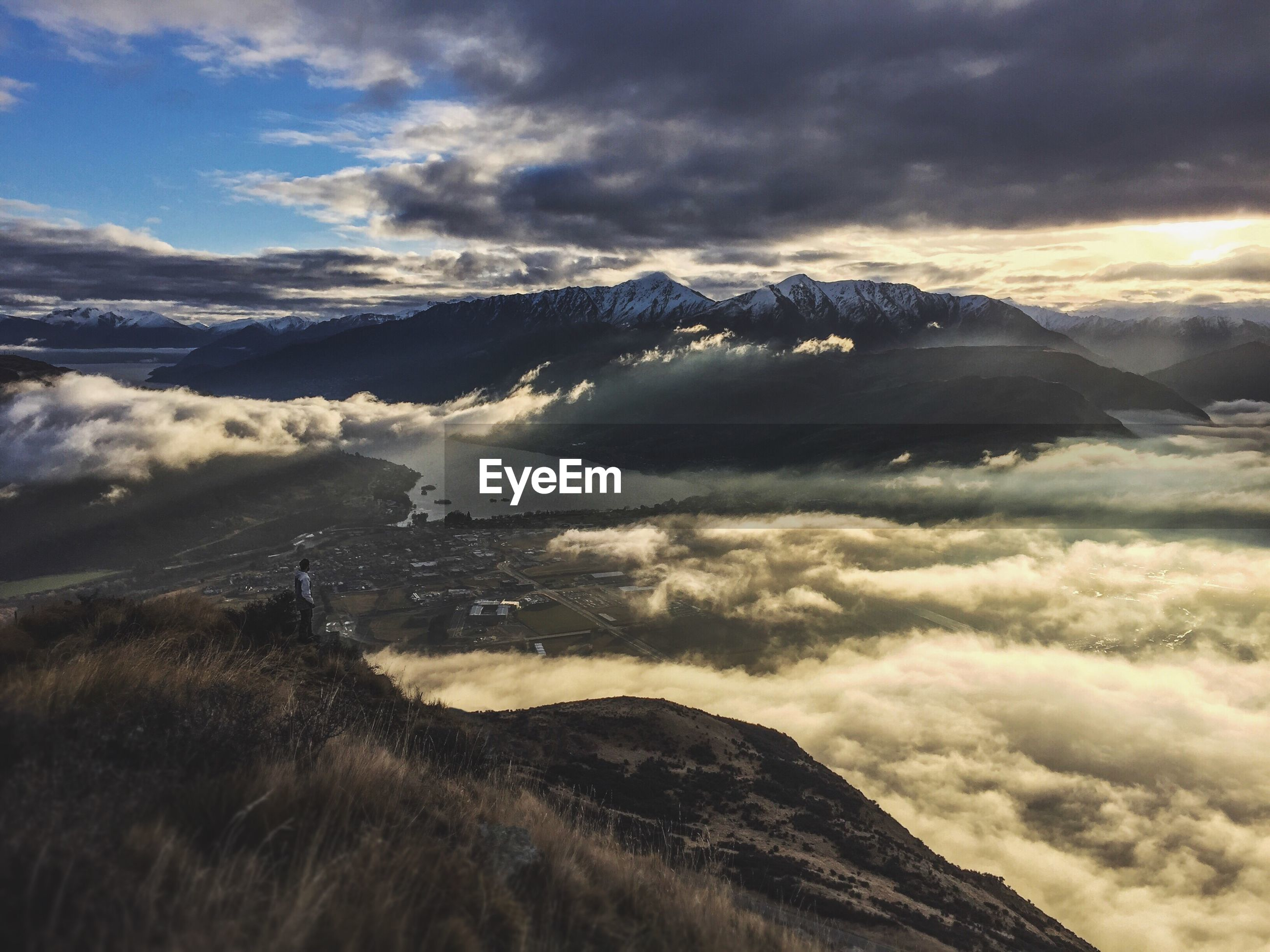SCENIC VIEW OF CLOUDSCAPE OVER MOUNTAINS