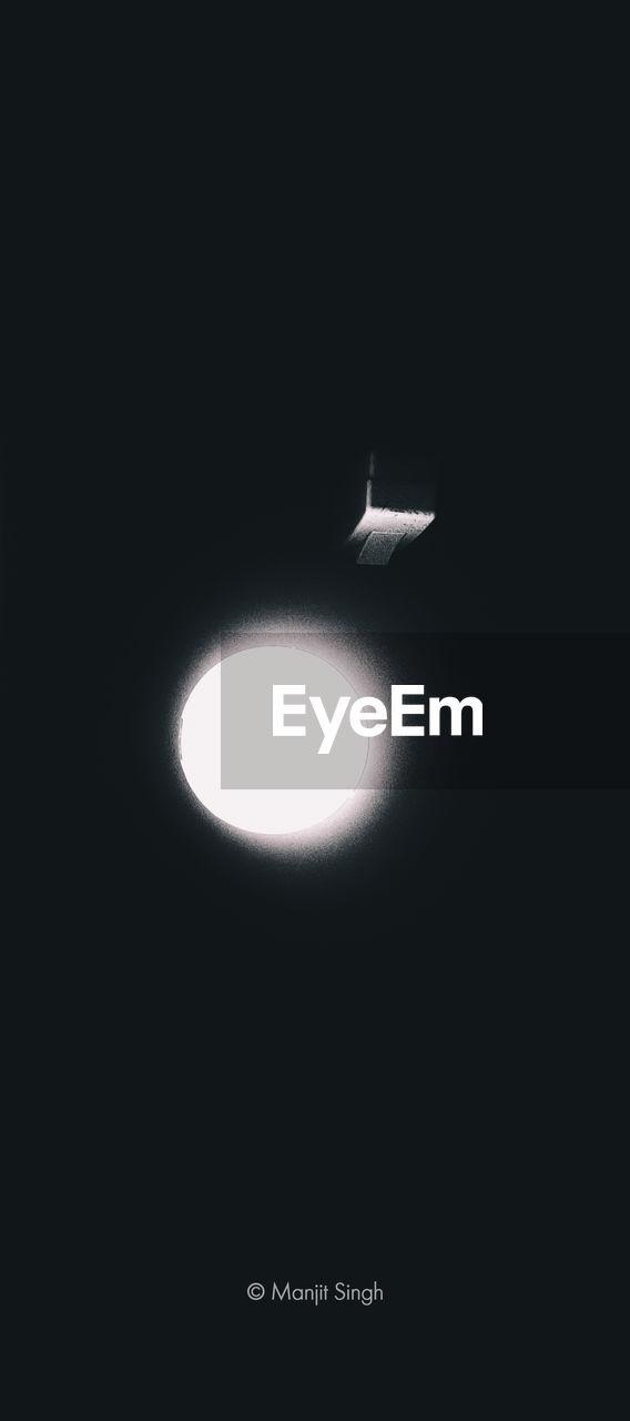 LOW ANGLE VIEW OF ILLUMINATED LIGHTING EQUIPMENT