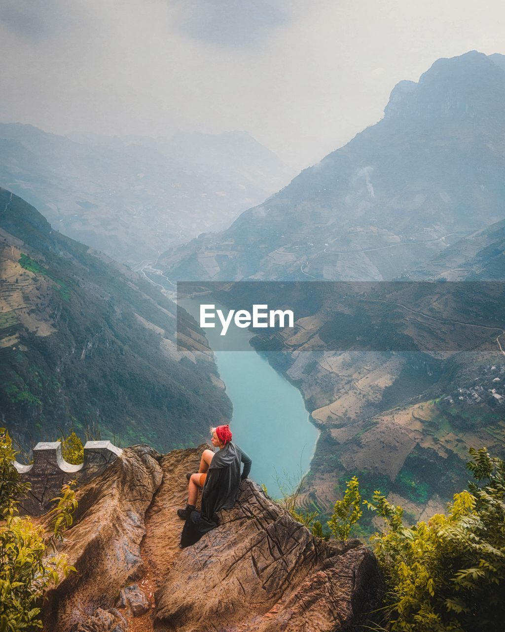 Woman looking at mountain range