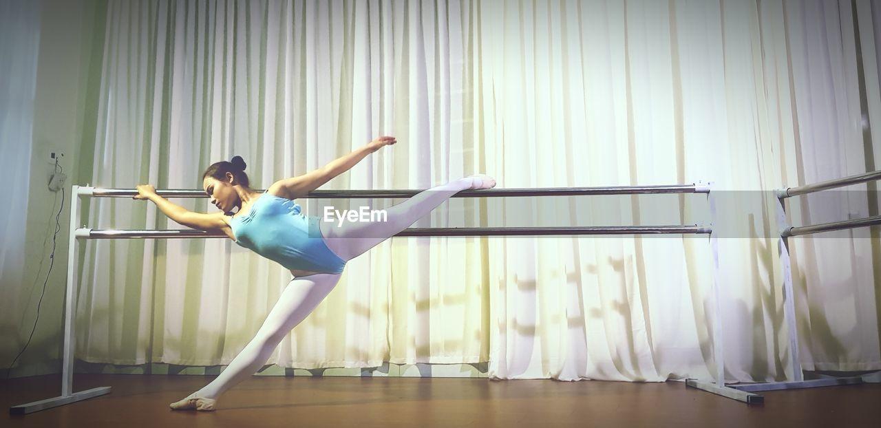 Full Length Of Woman Dancing At Ballet Studio
