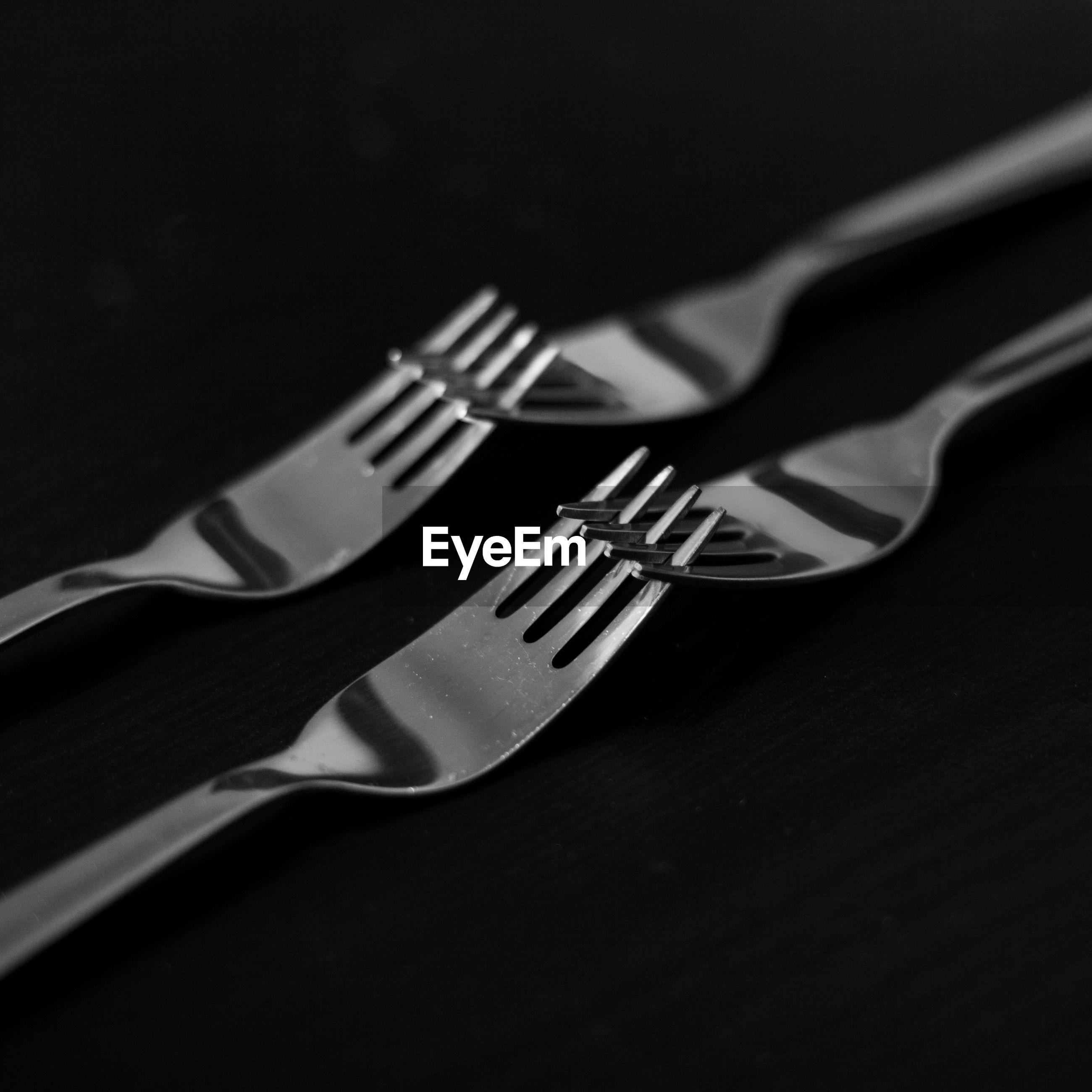 Close-up of forks against black background