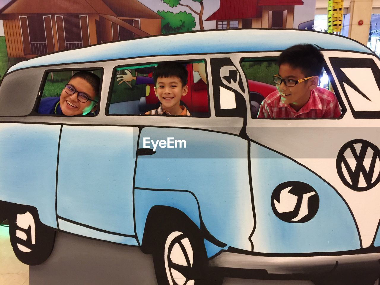 car, boys, real people, transportation, childhood, day, land vehicle, mode of transport, elementary age, fun, headshot, leisure activity, happiness, looking at camera, outdoors, sitting, portrait, lifestyles, smiling, togetherness, eyeglasses, friendship, young adult, close-up, people