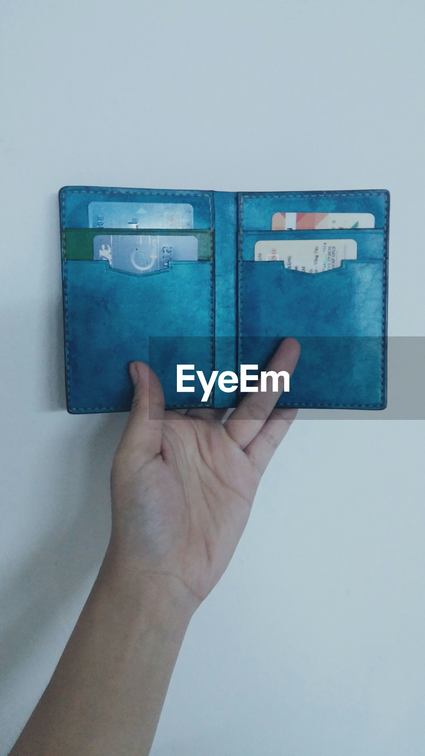 person, part of, cropped, blue, indoors, copy space, wall - building feature, human finger, paper, holding, communication, text, creativity, close-up, personal perspective, wall, art