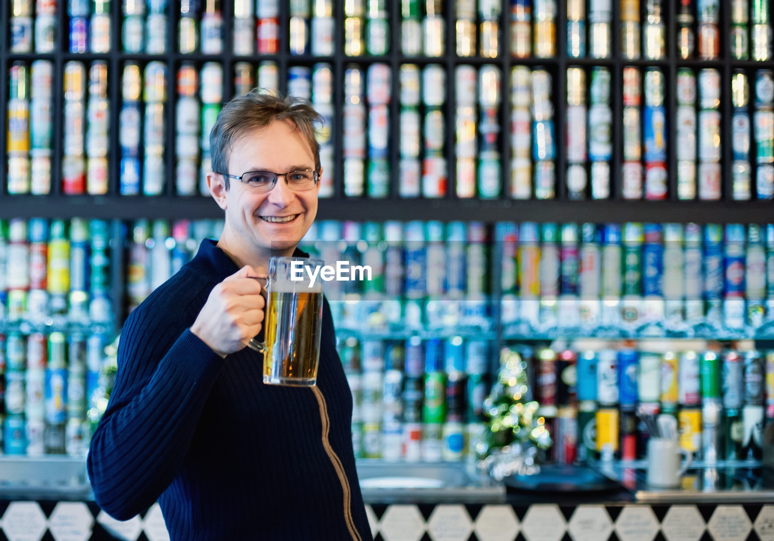 Portrait of smiling man holding beer glass