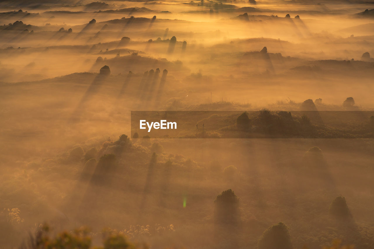 High angle view of landscape against sky during sunrise