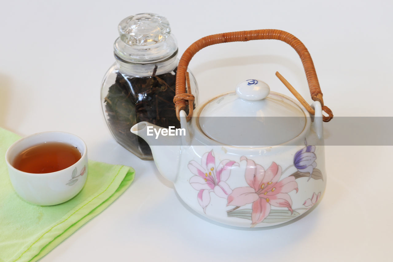 food and drink, drink, refreshment, tea, cup, tea - hot drink, teapot, mug, indoors, hot drink, still life, food, table, tea cup, high angle view, no people, container, freshness, studio shot, close-up, crockery, floral pattern