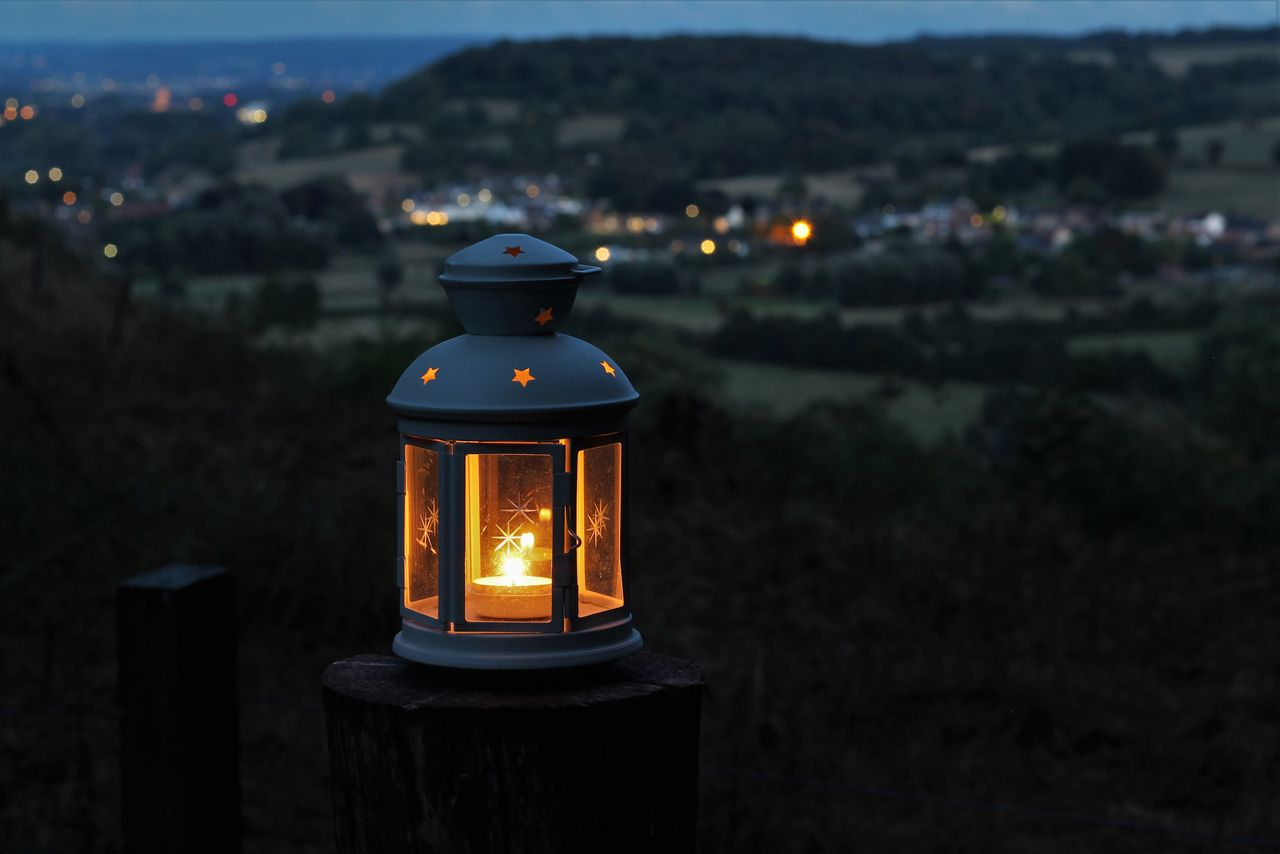 illuminated, burning, lighting equipment, nature, flame, fire, focus on foreground, architecture, candle, fire - natural phenomenon, built structure, glowing, no people, building exterior, close-up, heat - temperature, outdoors, dusk, building, glass - material, tea light, electric lamp