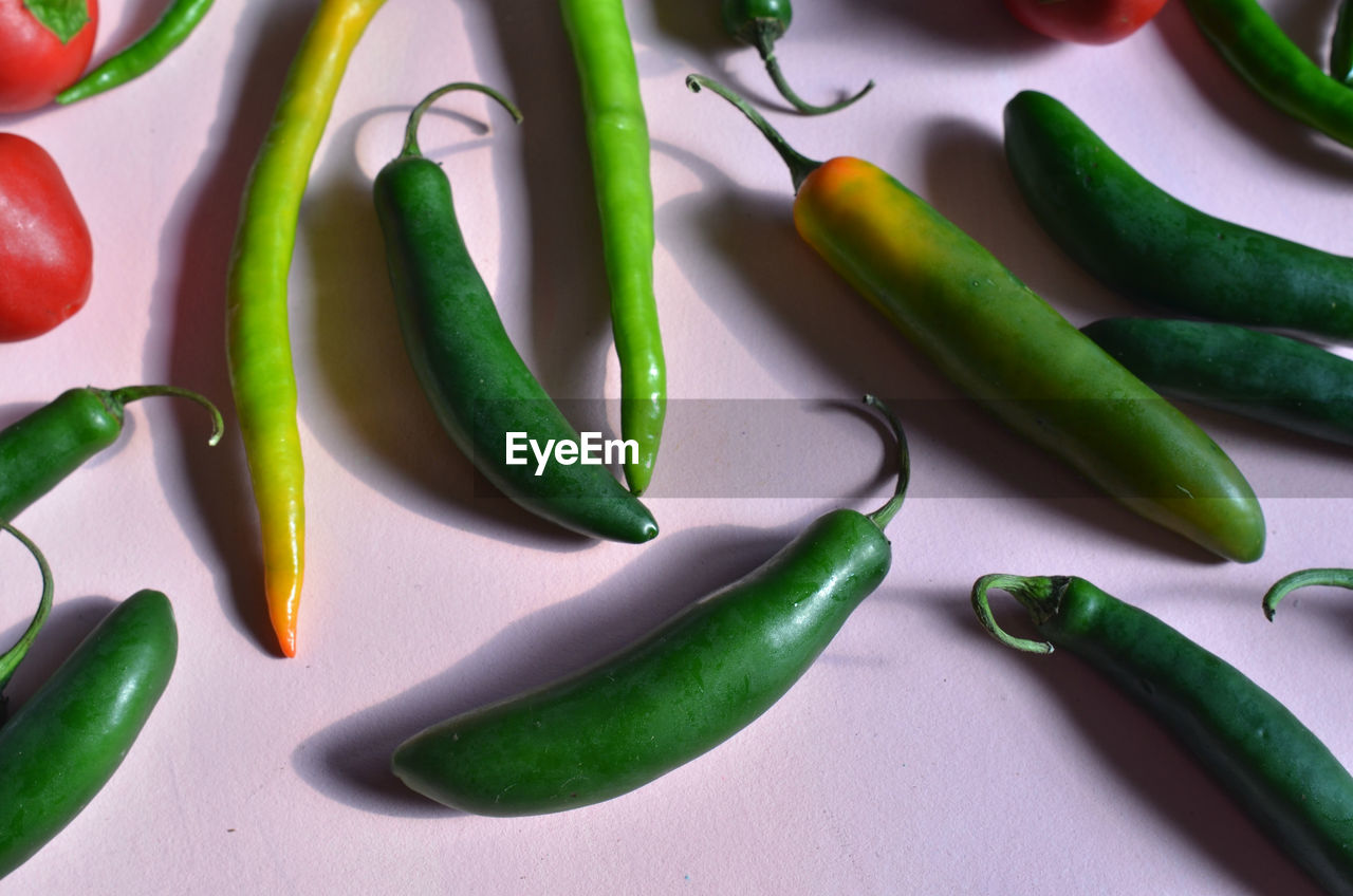 vegetable, pepper, chili pepper, food, food and drink, green color, freshness, still life, green chili pepper, wellbeing, table, indoors, healthy eating, close-up, spice, high angle view, no people, multi colored, raw food, red chili pepper, jalapeno pepper